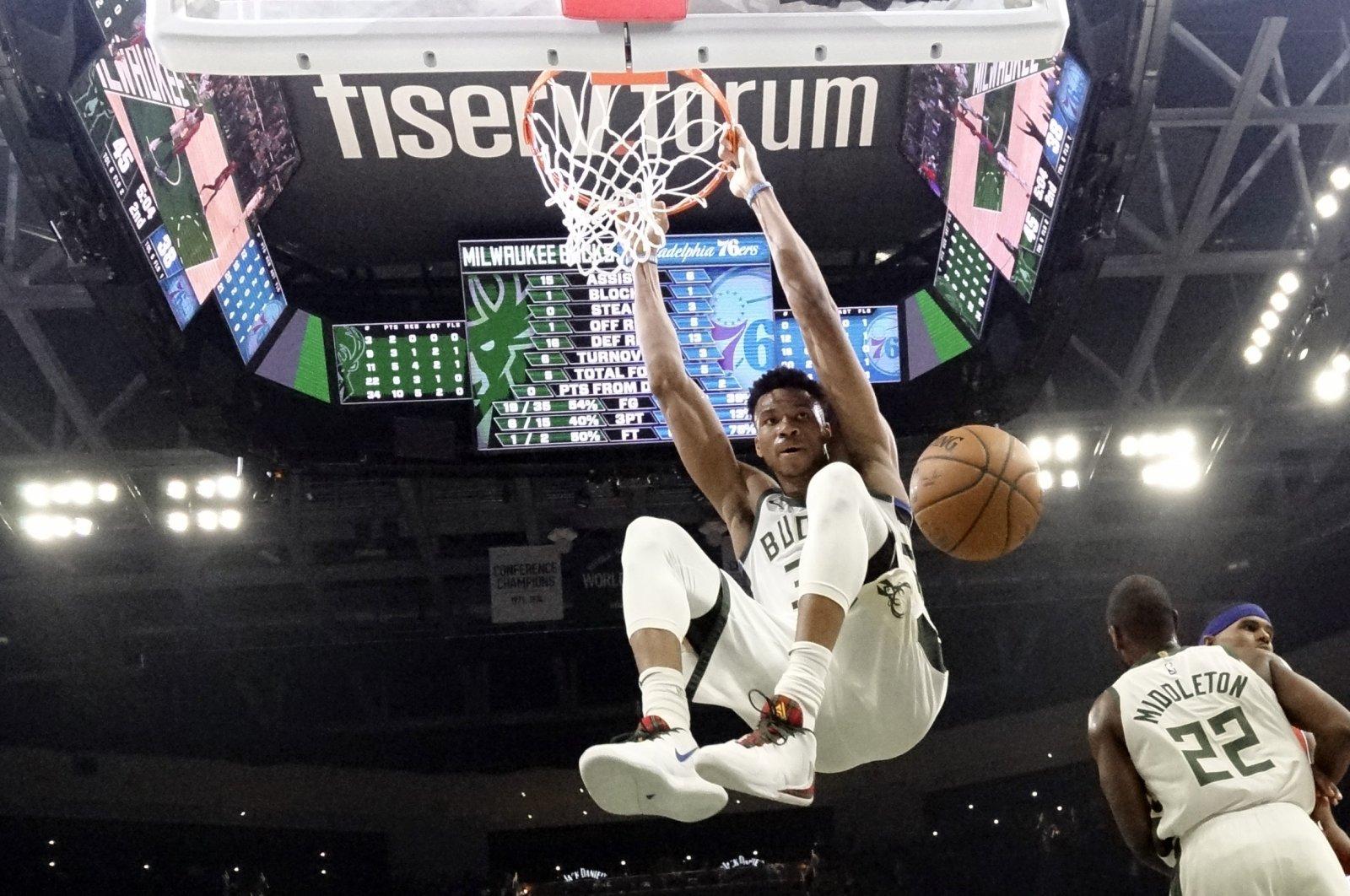 Milwaukee Bucks' Giannis Antetokounmpo dunks during an NBA game in Milwaukee, Wisconsin, U.S, Feb. 22, 2020. (AP Photo)
