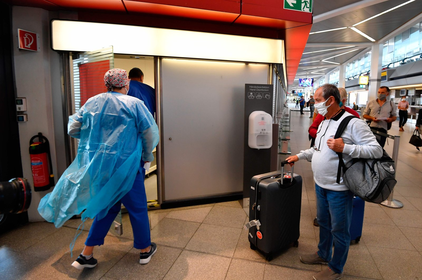 A passenger waits at a test station for the novel coronavirus that can cause the COVID-19 disease at terminal A of Berlin Tegel airport on July 29, 2020. (AFP Photo)