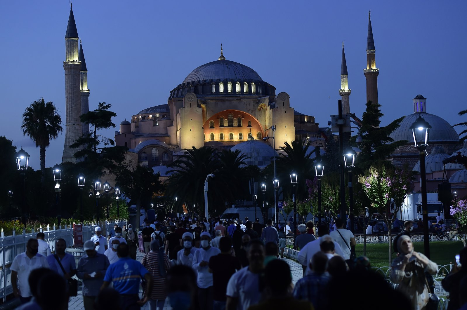 People walk backdropped by the Byzantine-era Hagia Sophia, in the historic Sultanahmet district of Istanbul, July 24, 2020. (AP Photo)