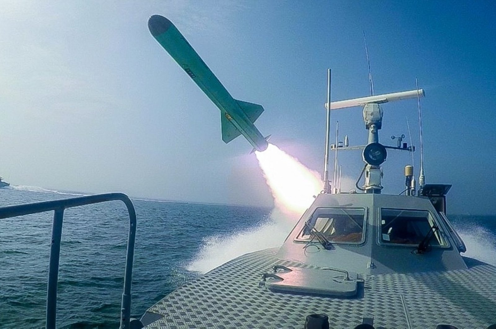 A missile is fired from a vessel during a military exercise near the Strait of Hormuz, July 28, 2020. (Iran's Revolutionary Guard / Sepah News Photo via AFP)