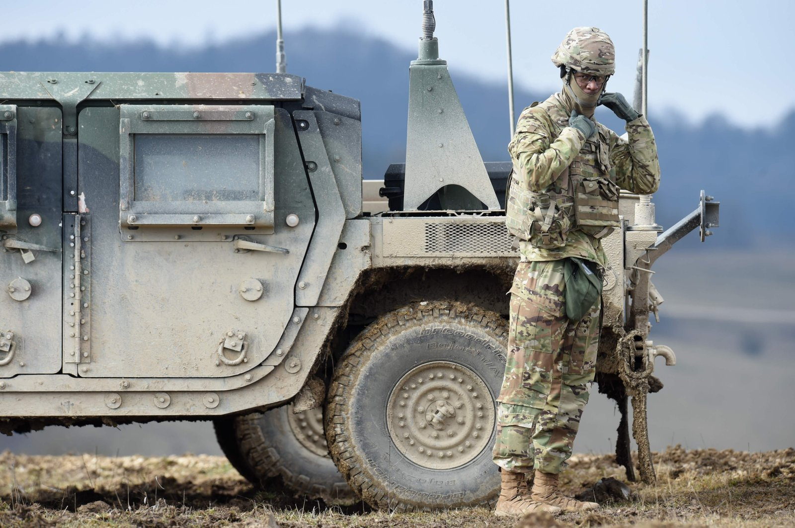 In this file photo a U.S. soldier waits prior to an artillery live fire event by the U.S. Army Europe's 41st Field Artillery Brigade at the military training area in Grafenwoehr, southern Germany, on March 4, 2020. (AFP Photo)