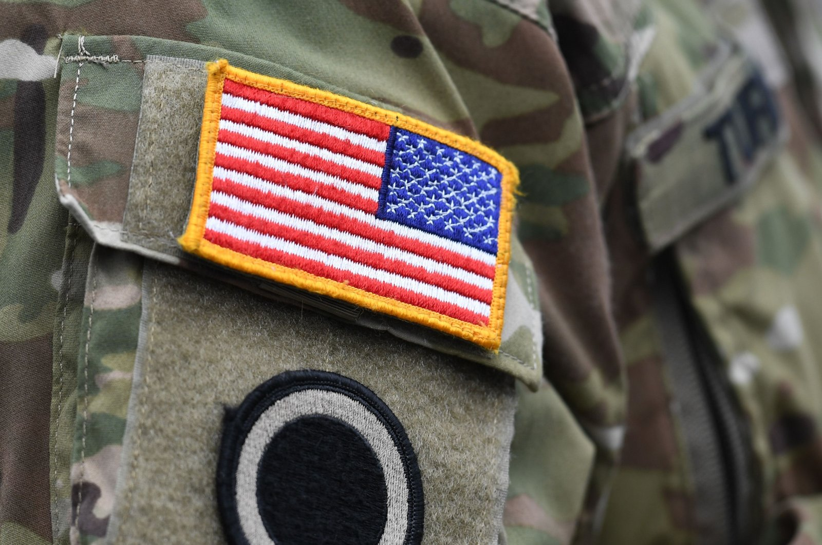 "A U.S. flag is pictured on a soldier's uniform during the ""Dynamic Front 18"" exercise, Grafenwoehr, near Eschenbach, March 7, 2018. (AFP Photo)"