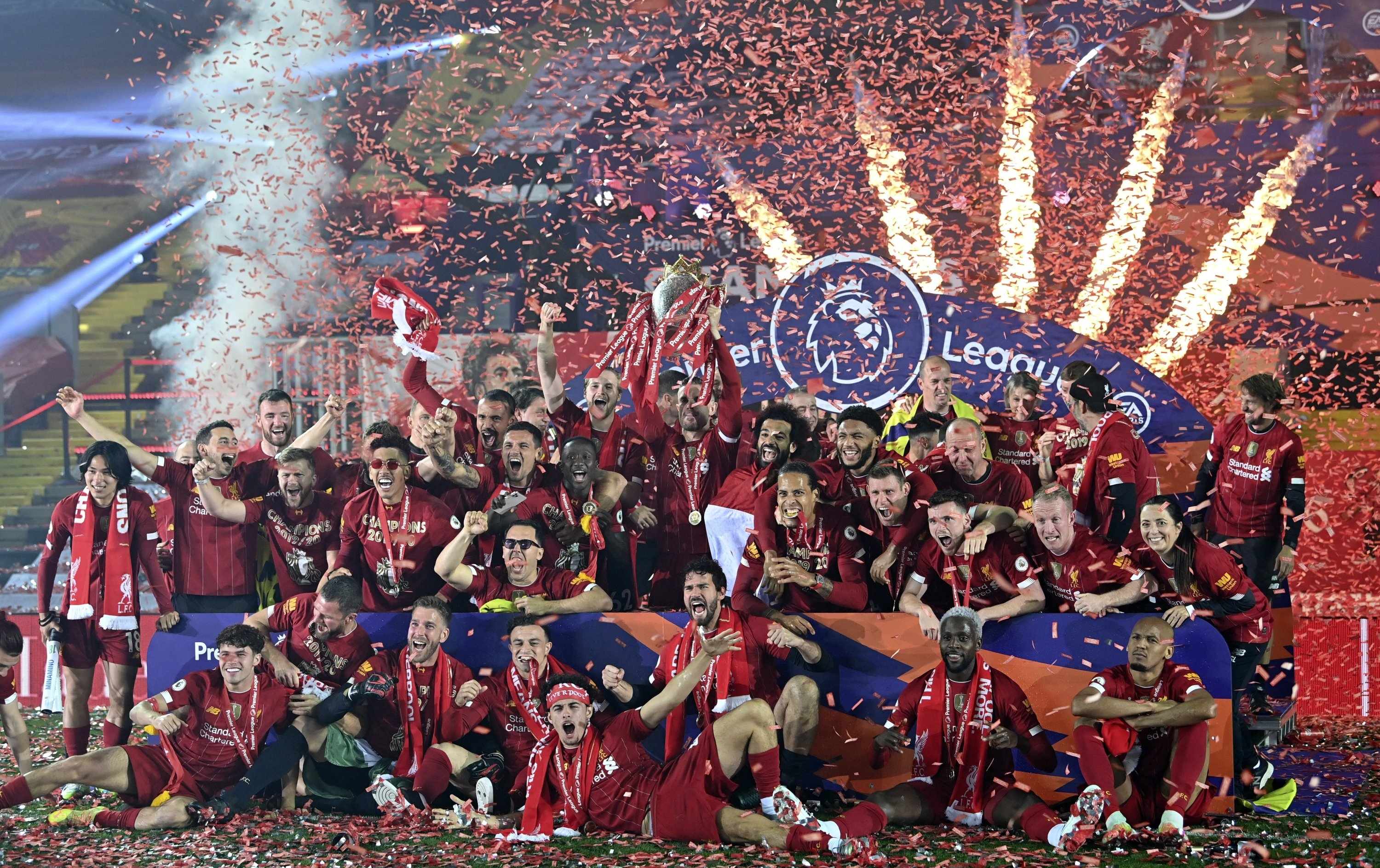 Liverpool players celebrate winning the Premier League with the trophy aloft in Liverpool, England, July 22, 2020. (AP Photo)