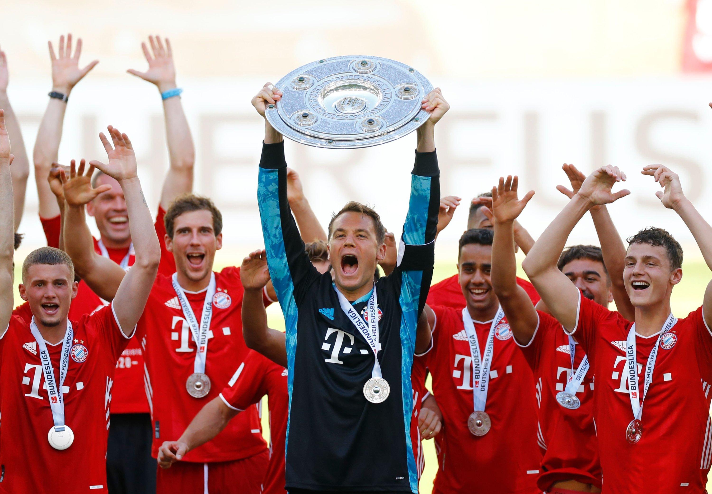 Manuel Neuer lifts the trophy as Bayern Munich players celebrate winning the German Bundesliga, Wolfsburg, Germany, June 27, 2020. (AFP Photo)