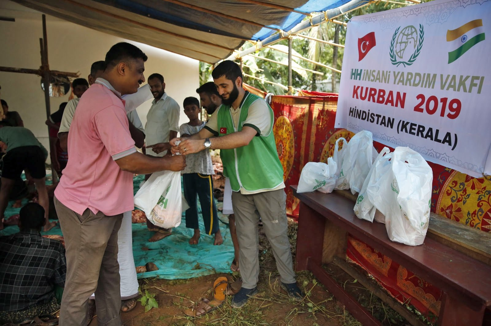 Staff members of the Turkish charity IHH deliver aid on the occasion of Qurban Bayram, in Kerala, India, Aug. 12, 2019. (Courtesy of IHH)