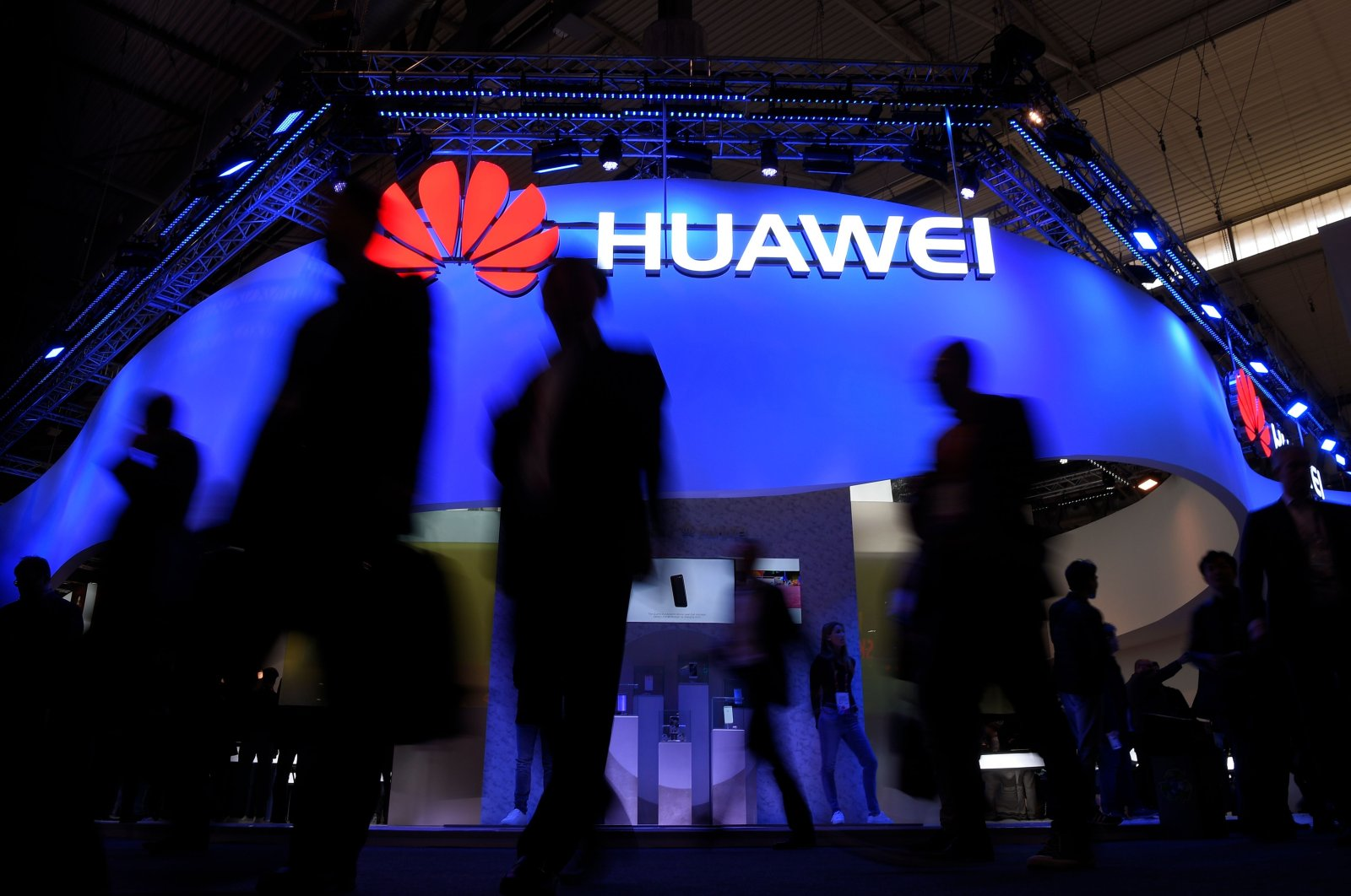 Visitors walk in front of the Huawei stand on the first day of the Mobile World Congress in Barcelona, Spain, Feb. 27, 2017. (AFP Photo)