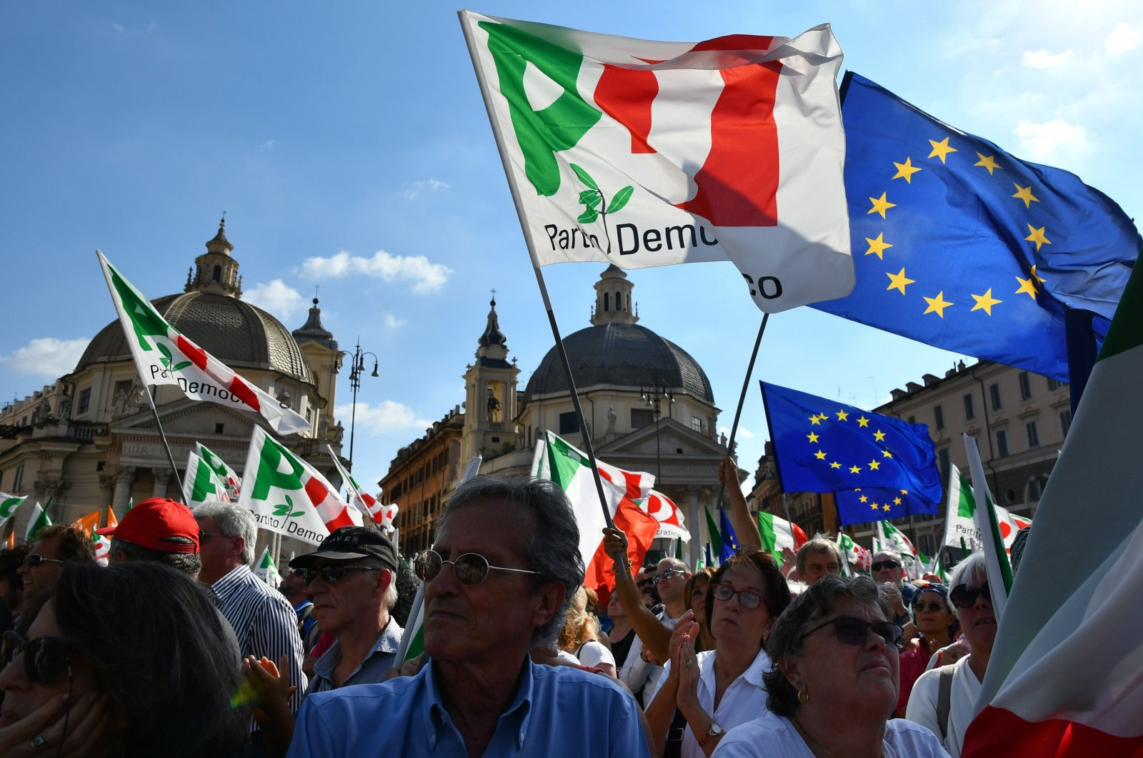 Supporters of Italy's center-left Democratic Party (PD) wave flags, Rome, Italy, Sept. 30, 2018. (AFP Photo)