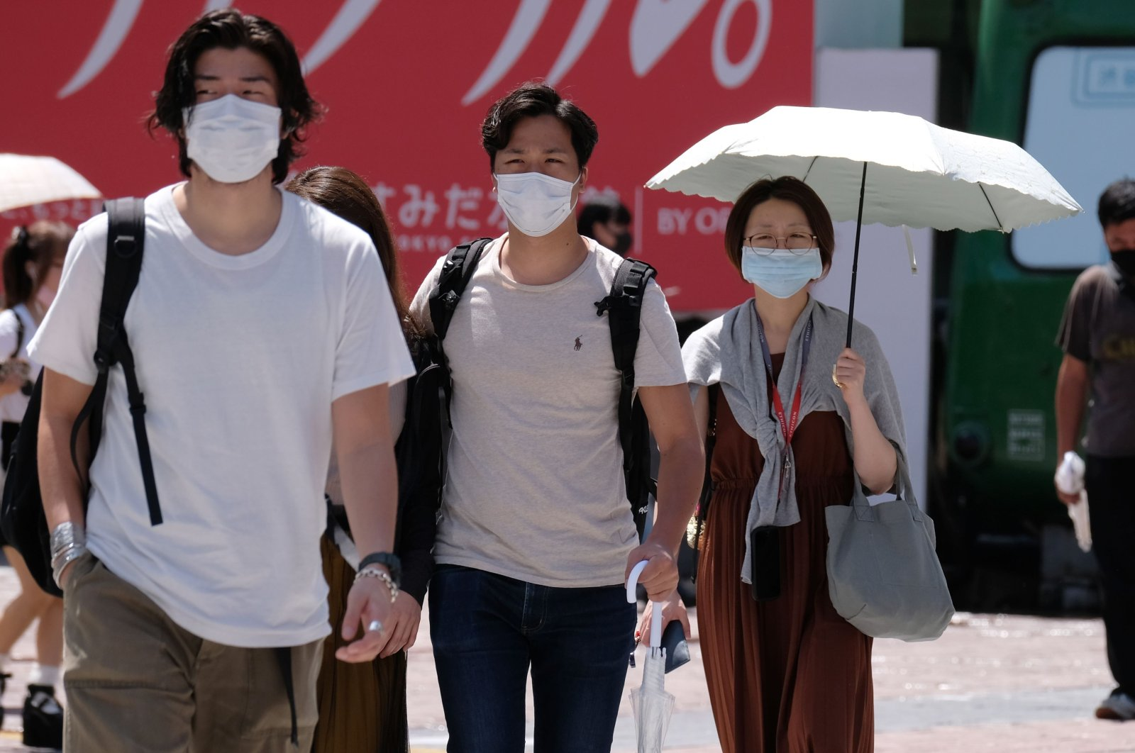 People wearing face masks walk across Shibuya Crossing in the Shibuya shopping and entertainment district in Tokyo, Japan, July 26, 2020. (AFP Photo)