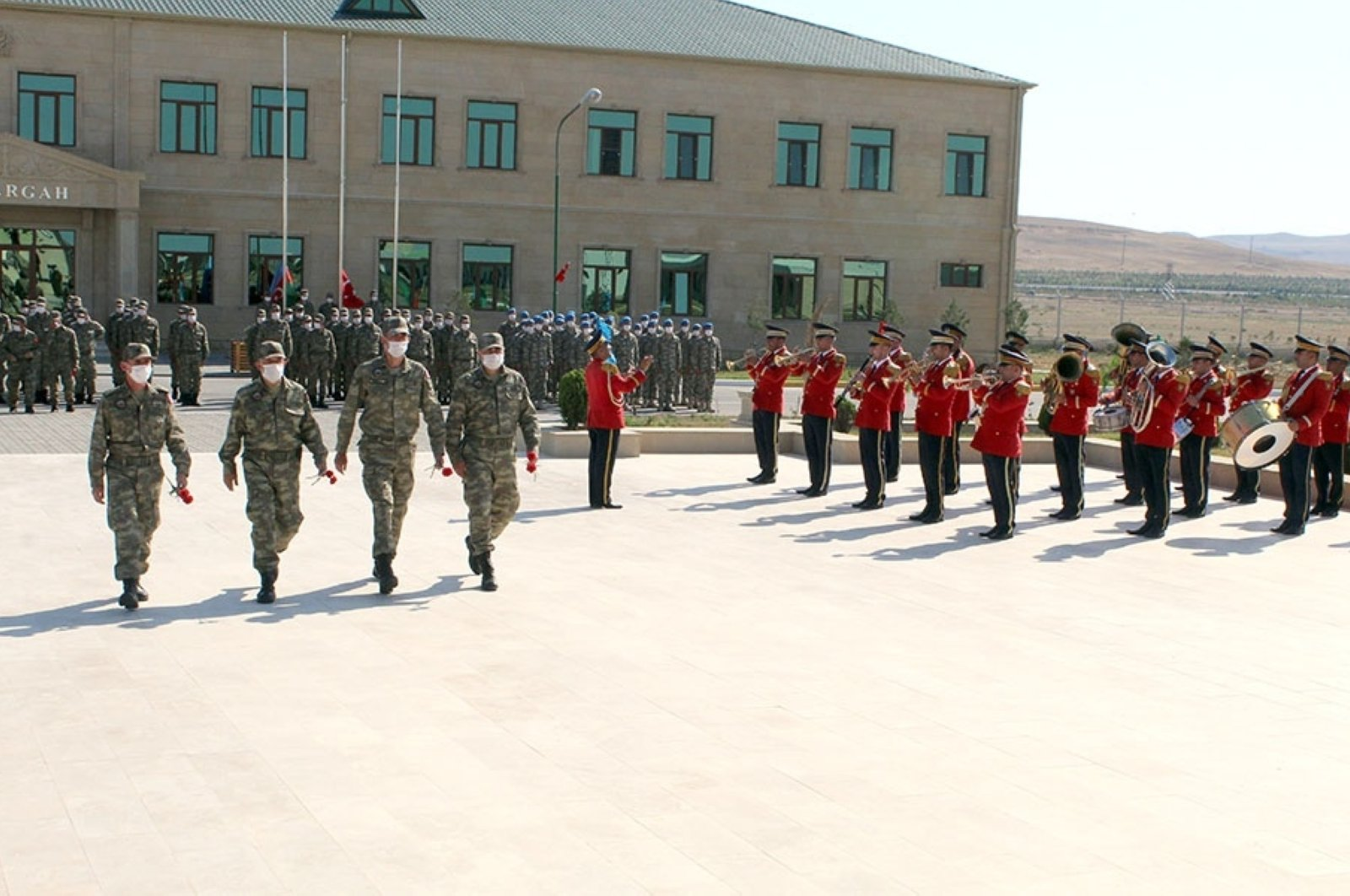 Azeri soldiers welcome Turkish soldiers, who landed in Baku for a joint military exercise, with a military ceremony, Baku, July 28, 2020. (AA Photo)