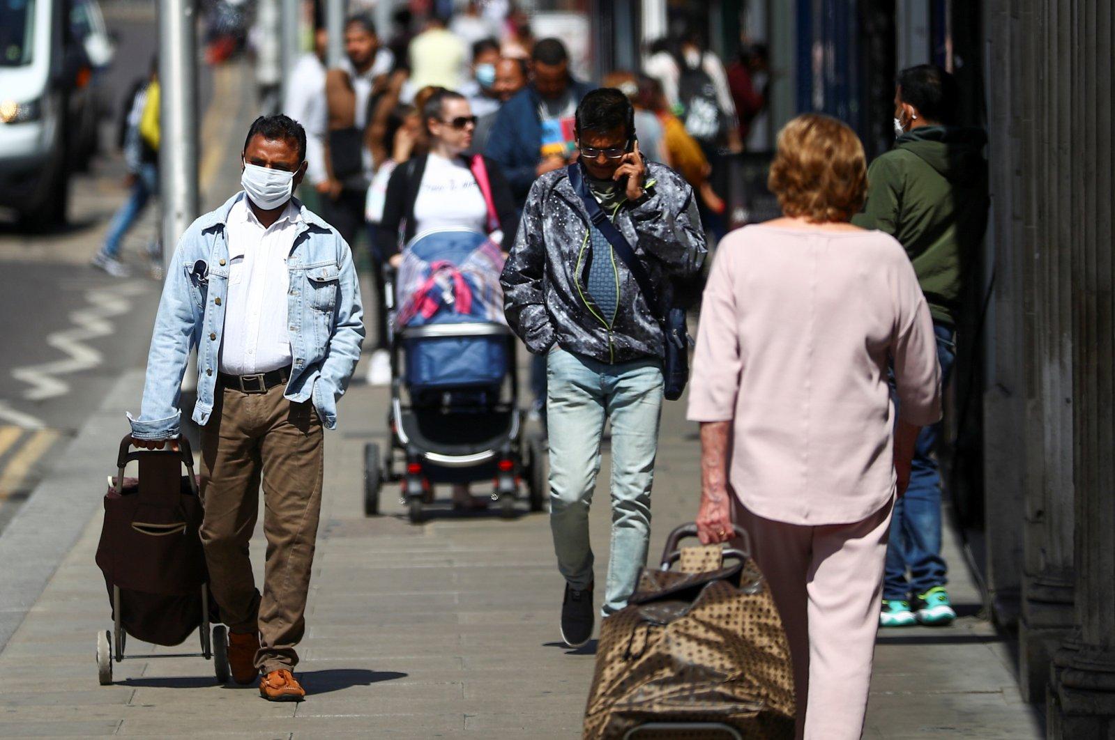 People walk down a street following the coronavirus outbreak, London, Britain, July 29, 2020. (Reuters Photo)