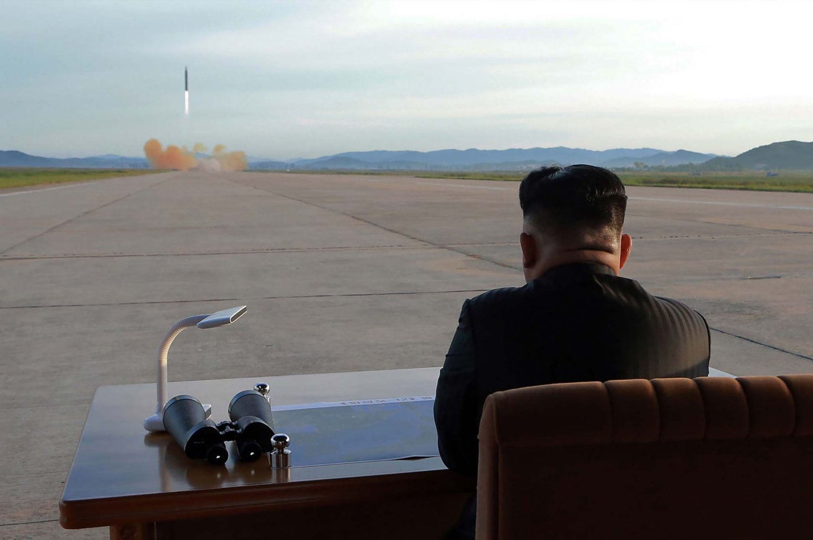 This picture shows North Korean leader Kim Jong Un inspecting a launching drill of the medium- and long-range strategic ballistic rocket Hwasong-12 at an undisclosed location. (AFP Photo / KCNA via KNS)