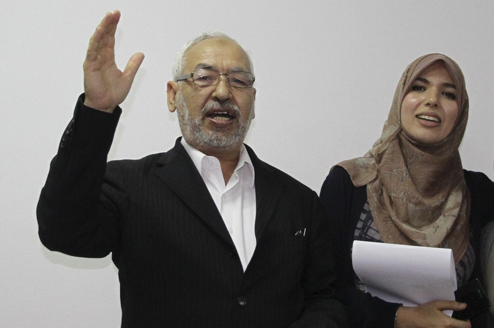 Rashid al-Ghannushi, Tunisian leader and founder of the moderate party Ennahda, celebrates an electoral victory with his daughter at the party's headquarters in Tunis, Tunisia, Oct. 27, 2011. (AP Photo)