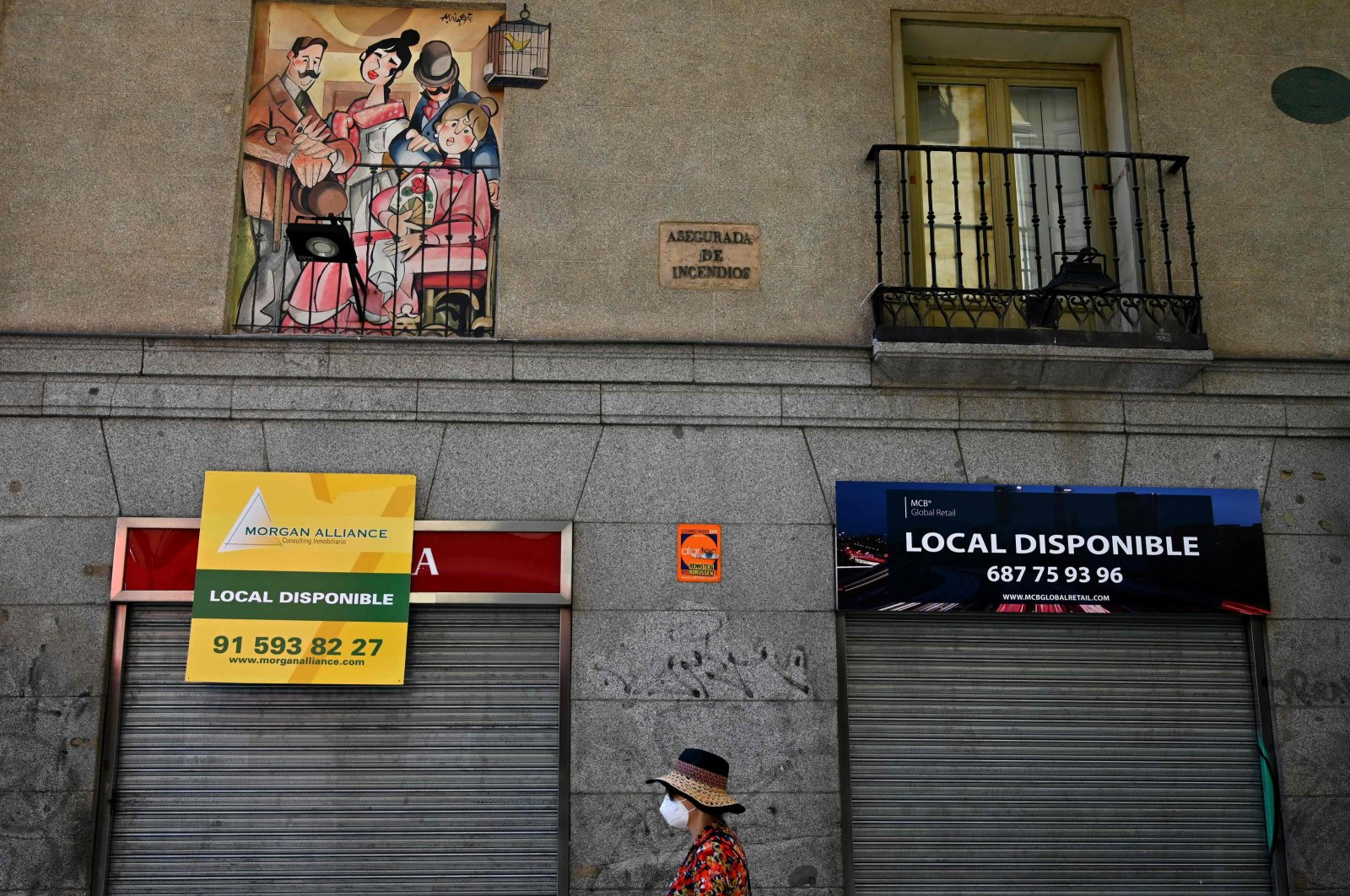 A woman walks past closed shops in Madrid, Spain, July 9, 2020. (AFP Photo)