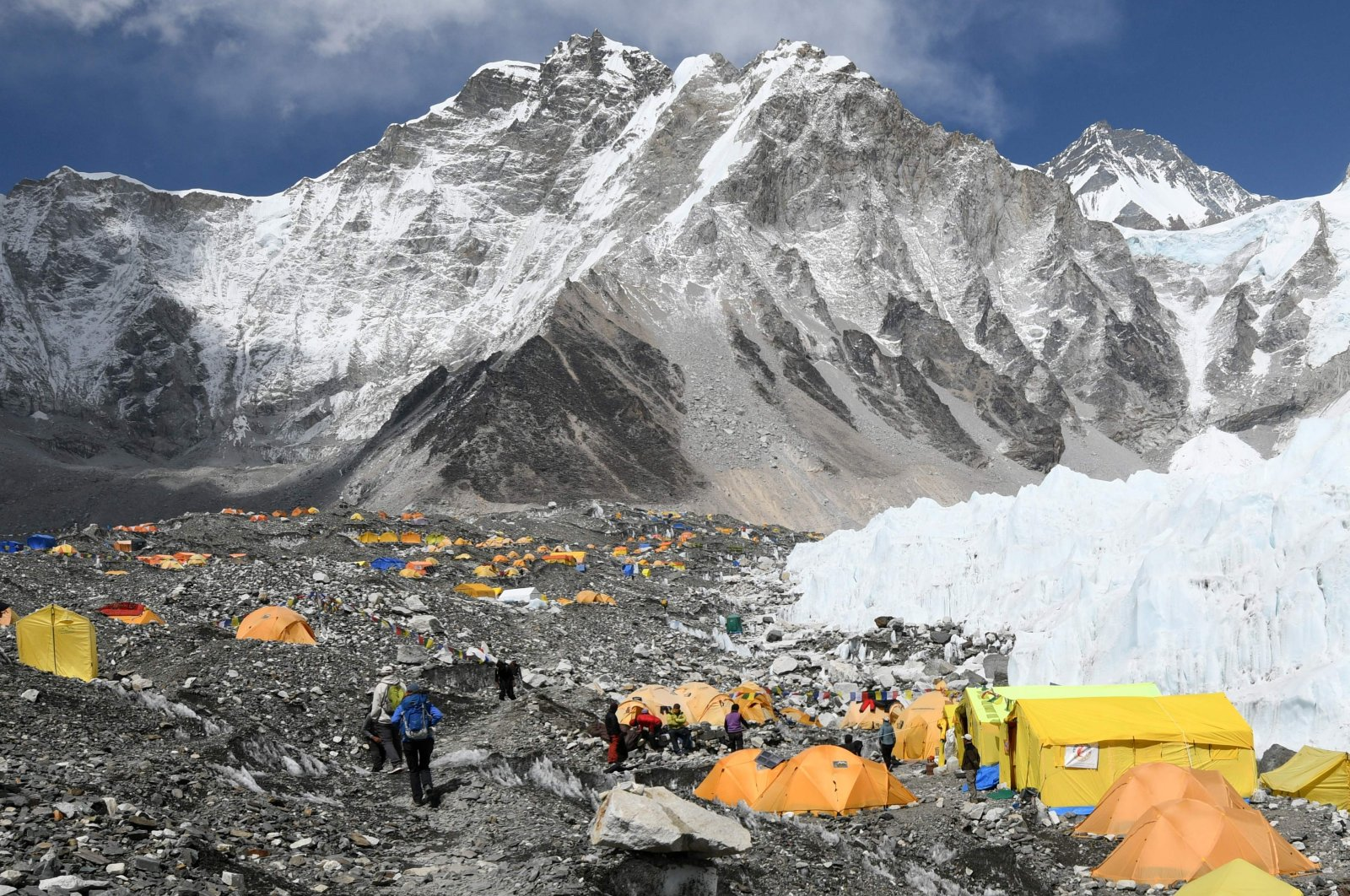 In this file photo taken on April 23, 2018, climbers and porters are seen by their tents at Everest base camp, some 140 kilometres northeast of Kathmandu. (AFP Photo)