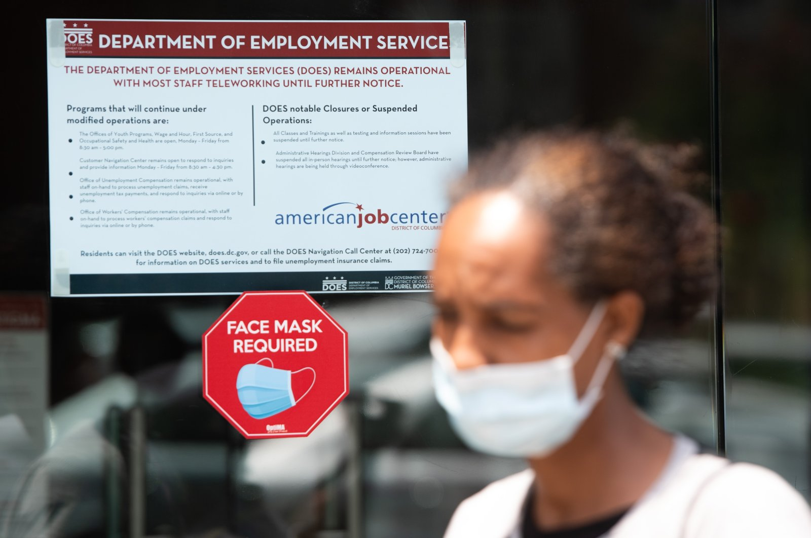 Diana Yitbarek, 44, leaves the D.C. Department of Employment Services after trying to find out about her unemployment benefits in Washington, D.C., July 16, 2020. (AFP Photo)