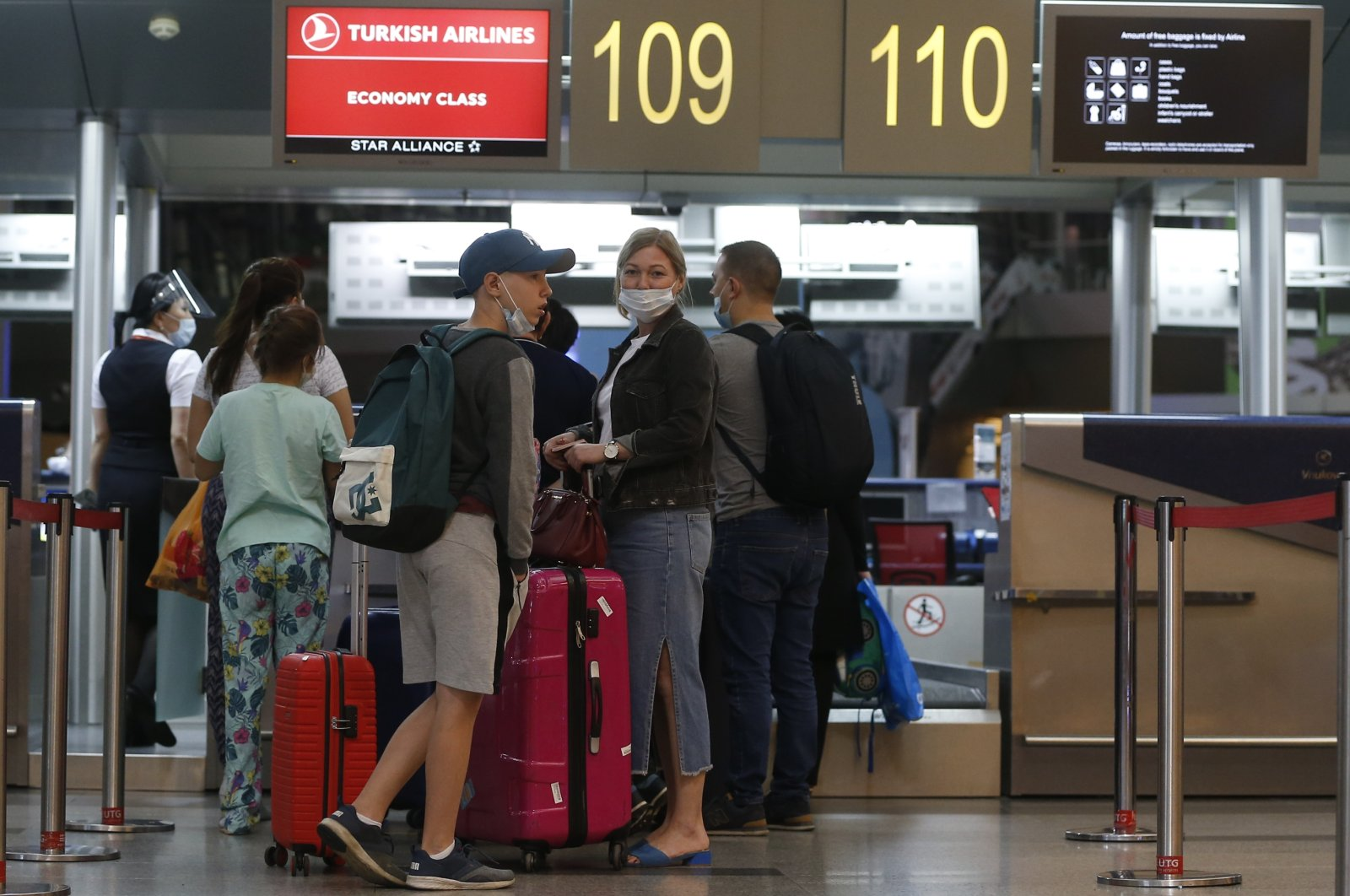 Passengers complete their check-ins for an Istanbul-bound Turkish Airlines flight at Vnukovo Airport in Moscow, Russia, Aug. 1, 2020. (AA Photo)