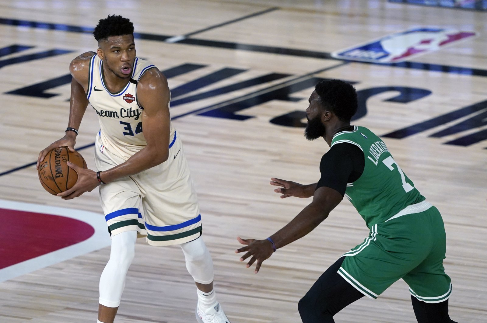 The Milwaukee Bucks' Giannis Antetokounmpo (L) looks to pass around the Boston Celtics' Jaylen Brown (R) during the first half of an NBA basketball game in Lake Buena Vista, Florida, July 31, 2020. (Ashley Landis/Pool Photo via USA Today Sports/Reuters)
