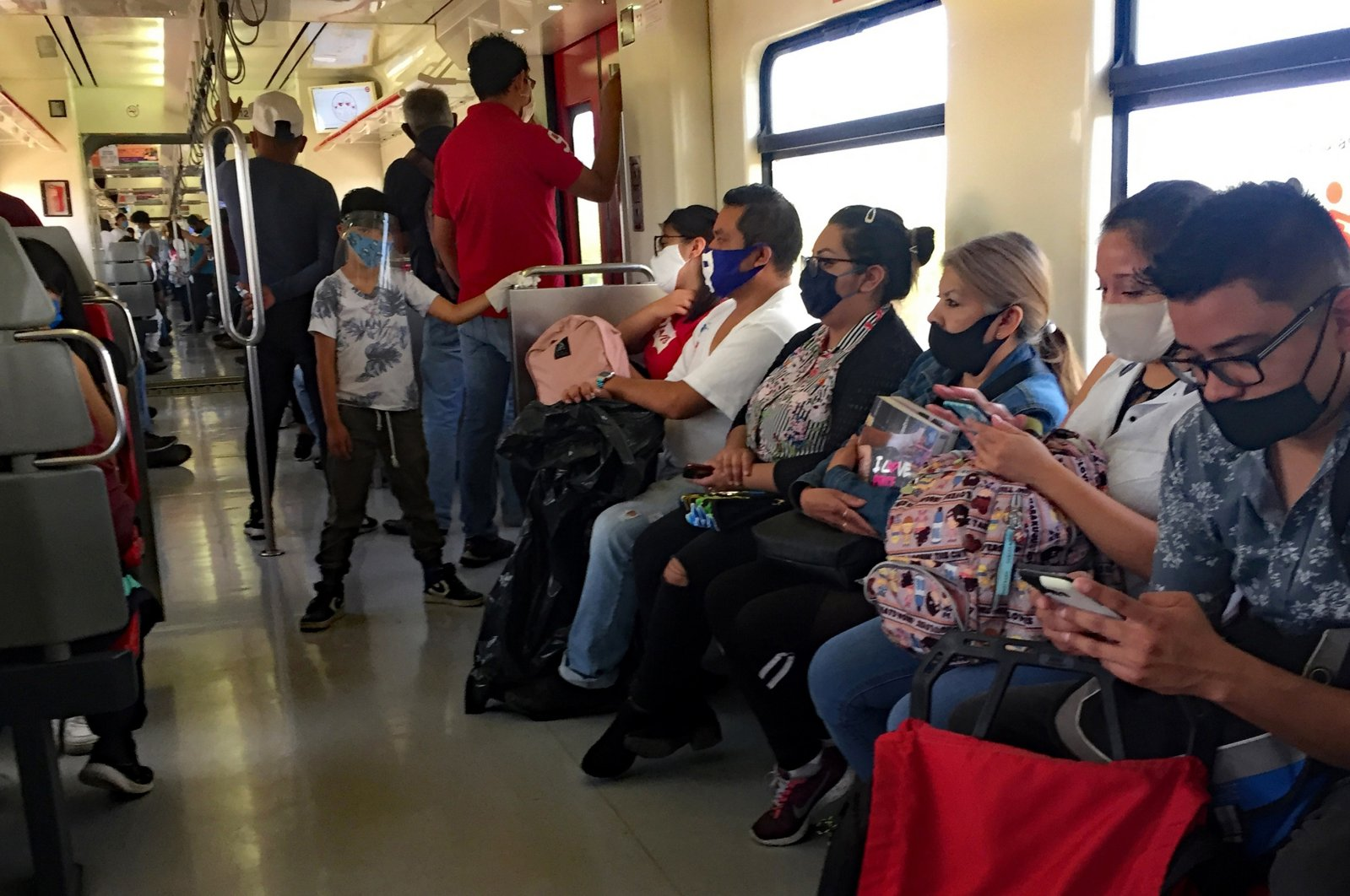 Commuters wear face masks on a Metrobus, Mexico City, July 21, 2020. (EPA Photo)