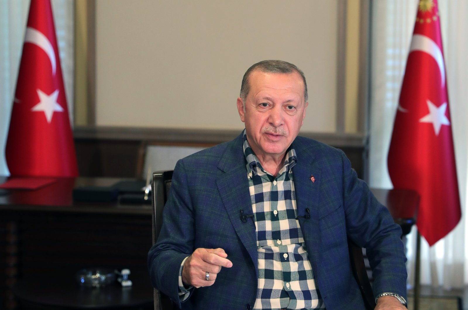 President Recep Tayyip Erdoğan addresses members of the ruling Justice and Development Party (AK Party) for Qurban Bayram greetings via video-link in Ankara, Turkey, Aug. 1, 2020. (AA Photo)