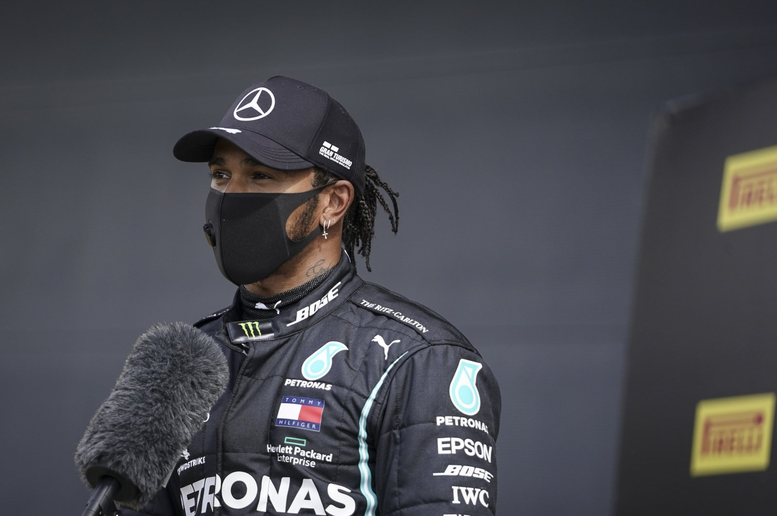 British Formula One driver Lewis Hamilton of Mercedes-AMG Petronas talks to media after he took pole position during the qualifying session of the British Formula One Grand Prix in Silverstone, Britain, 01 August 2020. (EPA Photo)