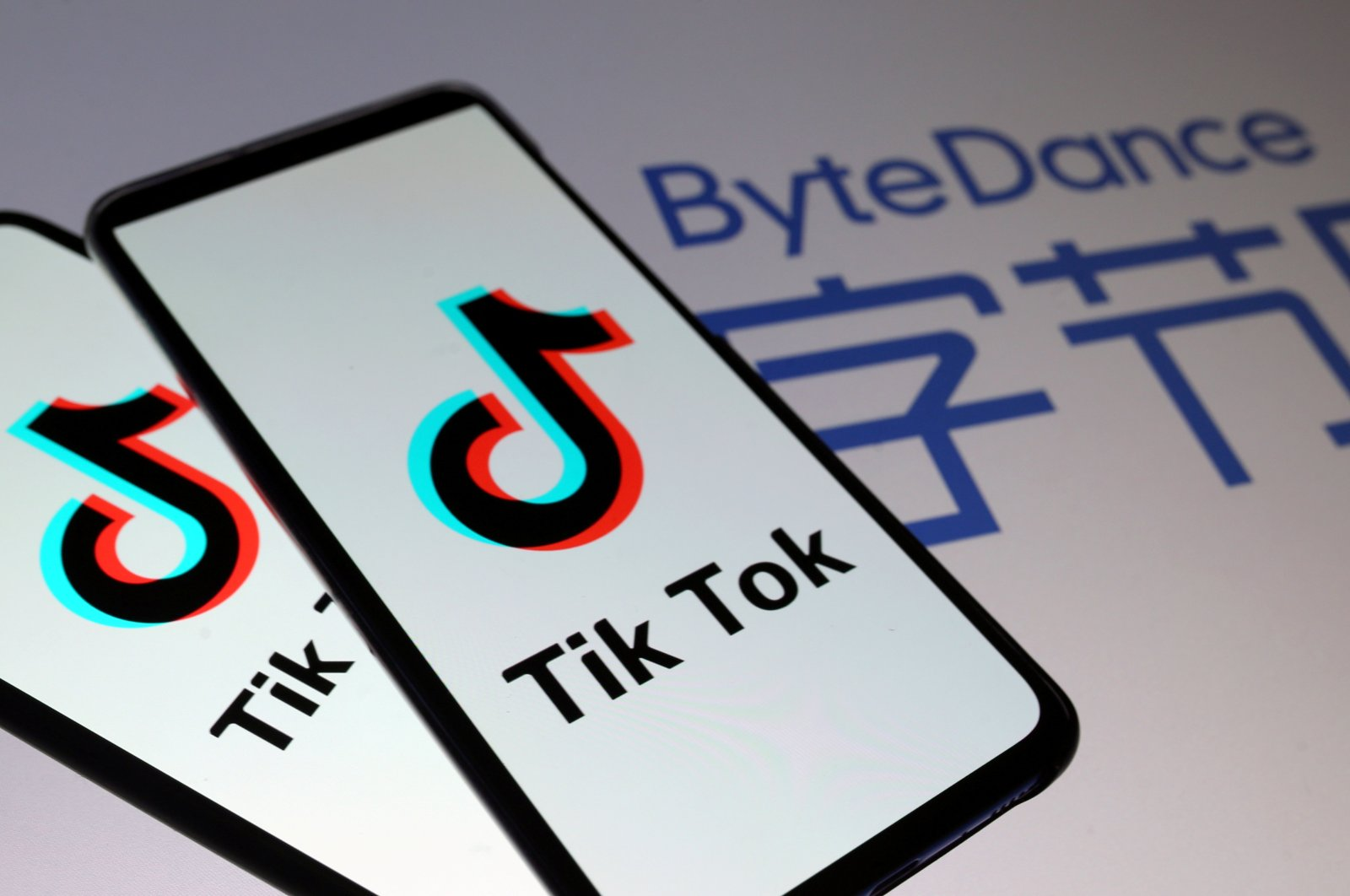 TikTok logos are seen on smartphones in front of a displayed ByteDance logo in this illustration taken November 27, 2019. (REUTERS Photo)