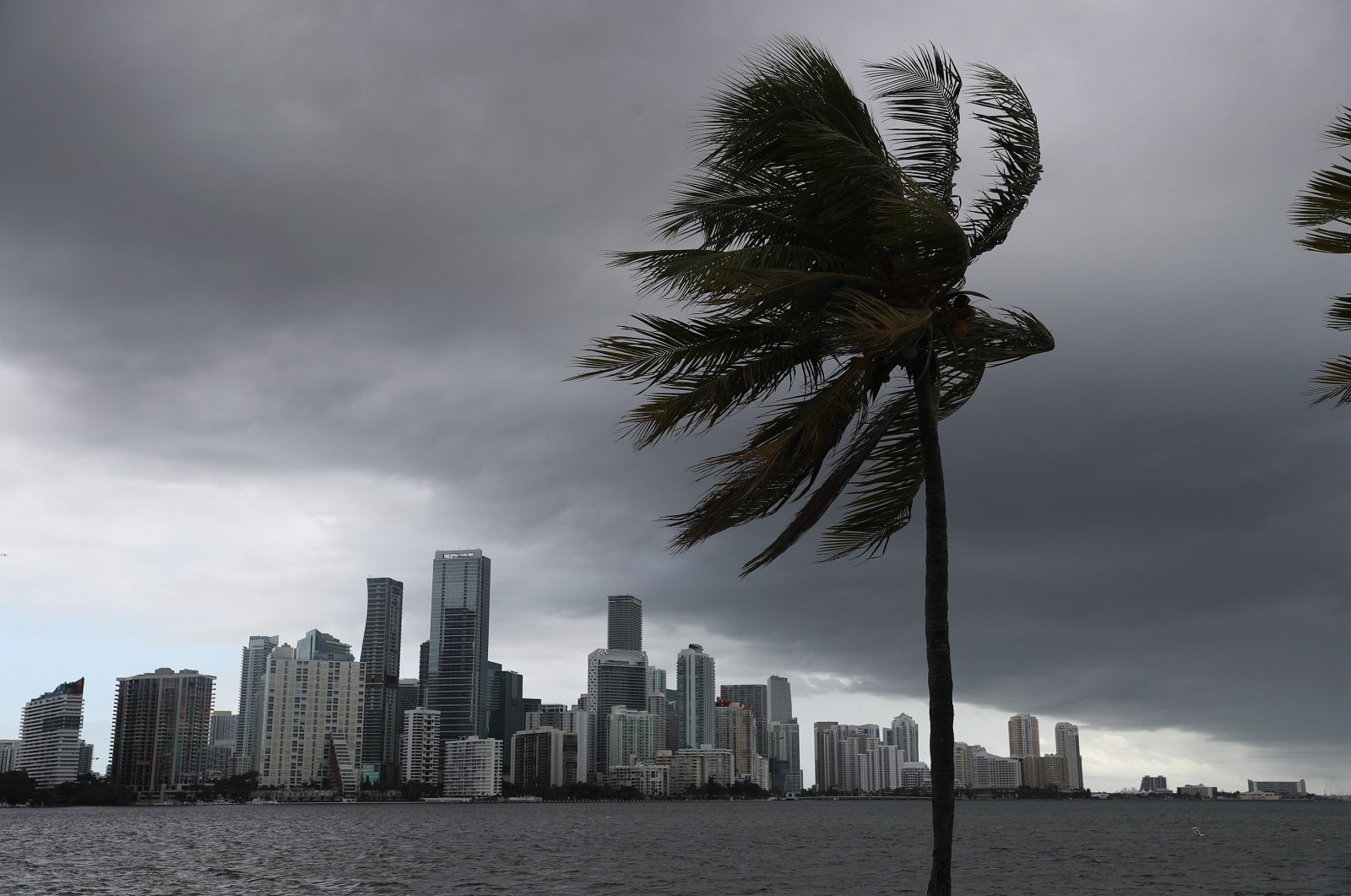 Storm clouds are seen over the city as Hurricane Isaias approaches the east coast of Florida on August 01, 2020 in Miami, Florida. (AFP Photo)