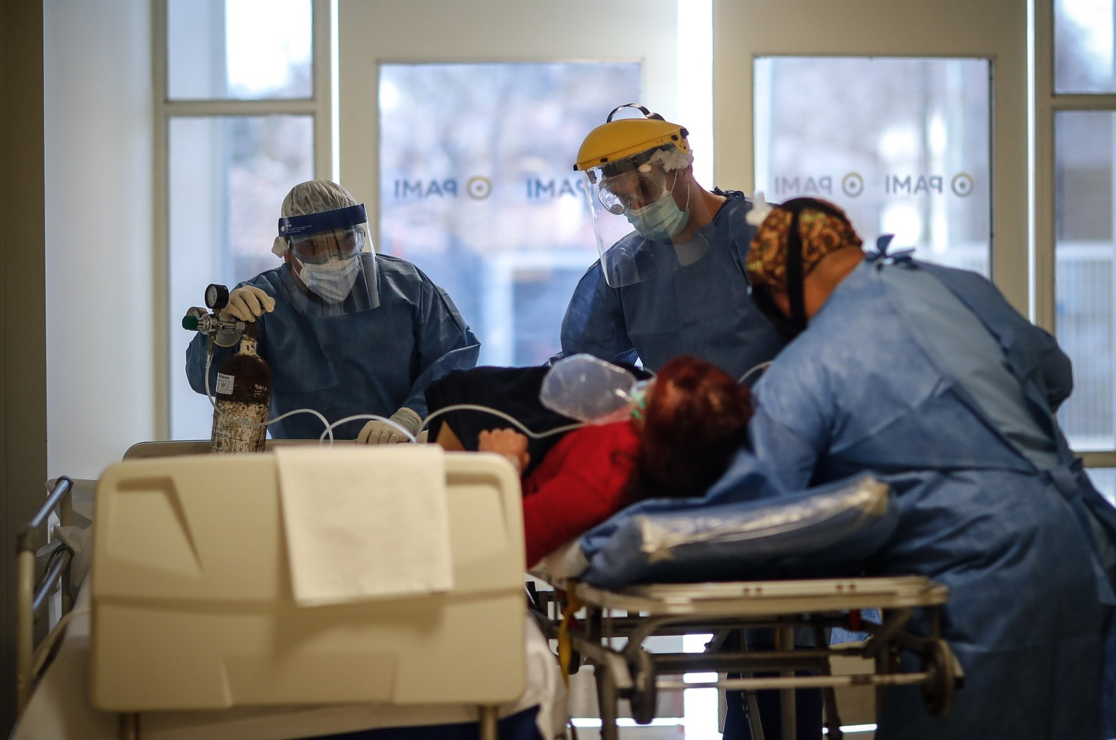 Medical personnel transport a COVID-19 patient at the Bicentennial Hospital of Esteban Echeverria in Buenos Aires, Argentina, on 30 July 2020 (EPA Photo)