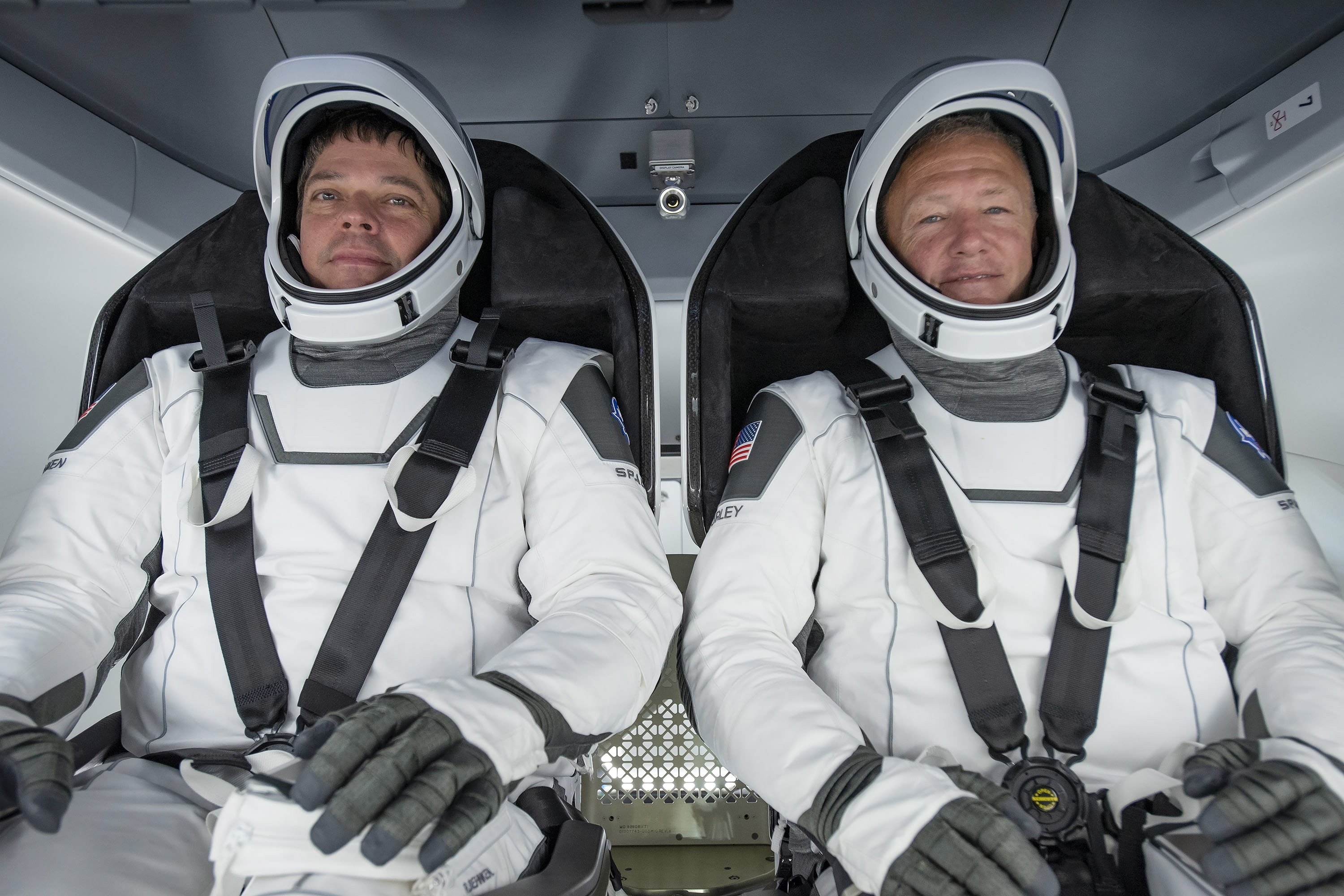 A handout picture made available by SpaceX shows NASA astronauts Bob Behnken (L) and Doug Hurley participating in a fully integrated test of SpaceX Crew Dragon flight hardware at the SpaceX processing facility on Cape Canaveral Air Force Station in Florida, U.S., March 30, 2020. (SpaceX handout via EPA)