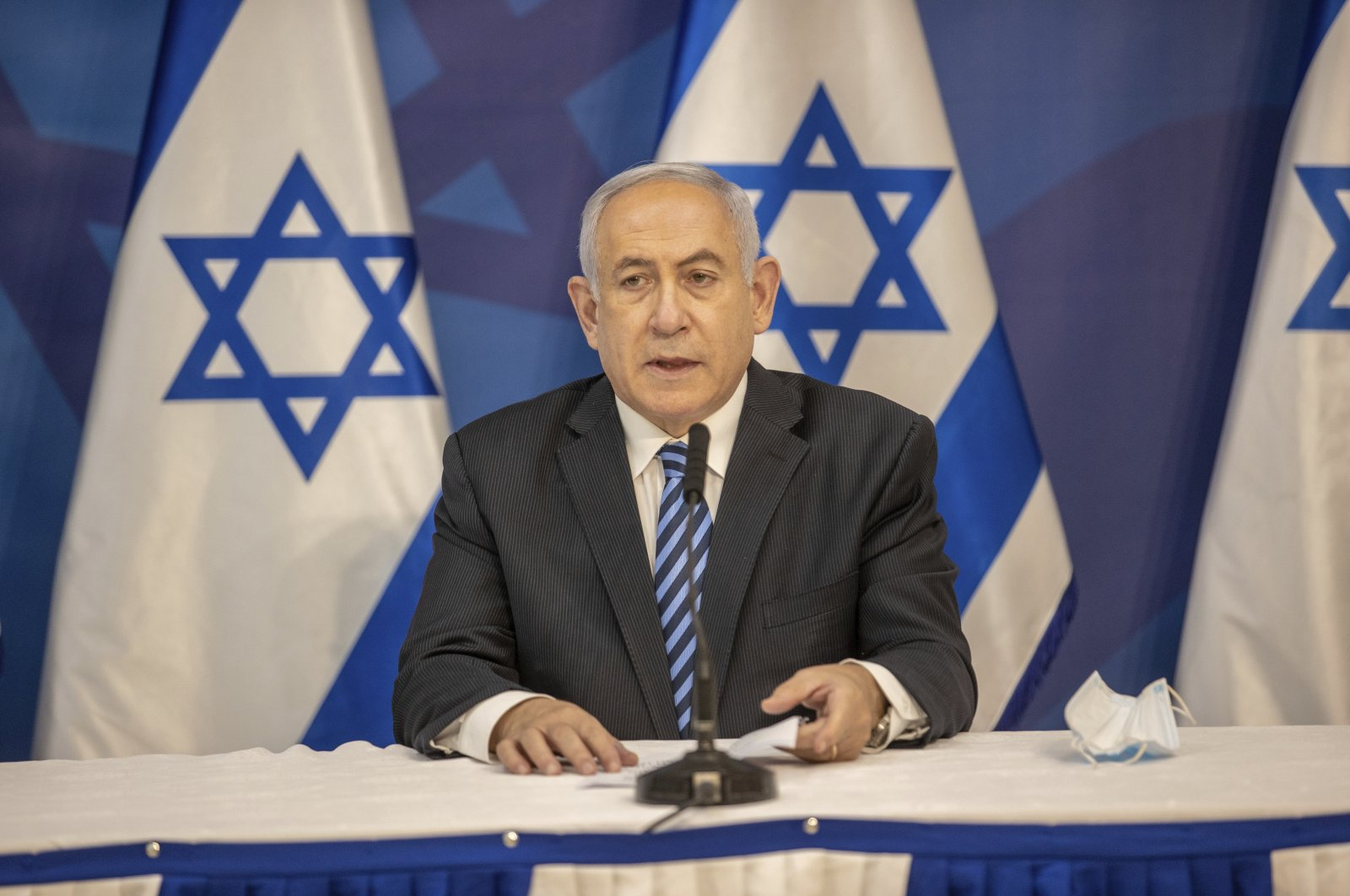 Israeli Prime Minister Benjamin Netanyahu issues a statement at the Israeli Defense Ministry in Tel Aviv, Israel, Monday, July 27, 2020. (AP Photo)
