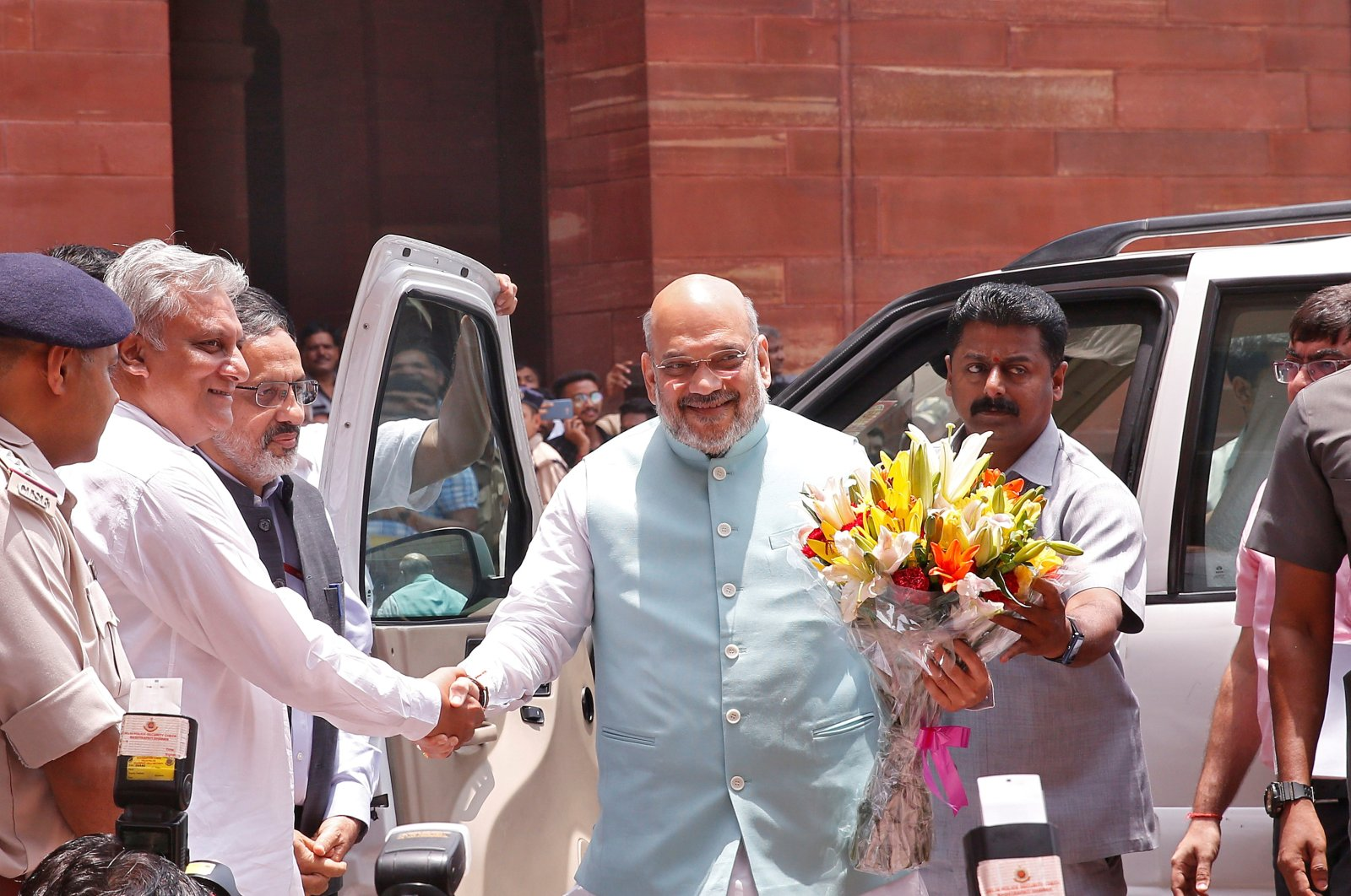 India's newly appointed Home Minister Amit Shah receives a flower bouquet upon his arrival at the home ministry in New Delhi, India, June 1, 2019. (REUTERS Photo)