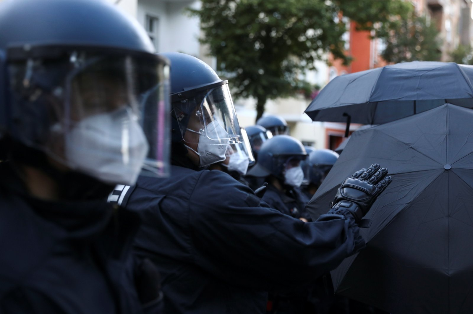 """Police officers wear face masks during a demonstration against the eviction of the pub """"Syndikat"""" and of the former group Liebig 34 in Berlin, Germany, Aug. 1, 2020. (Reuters Photo)"""
