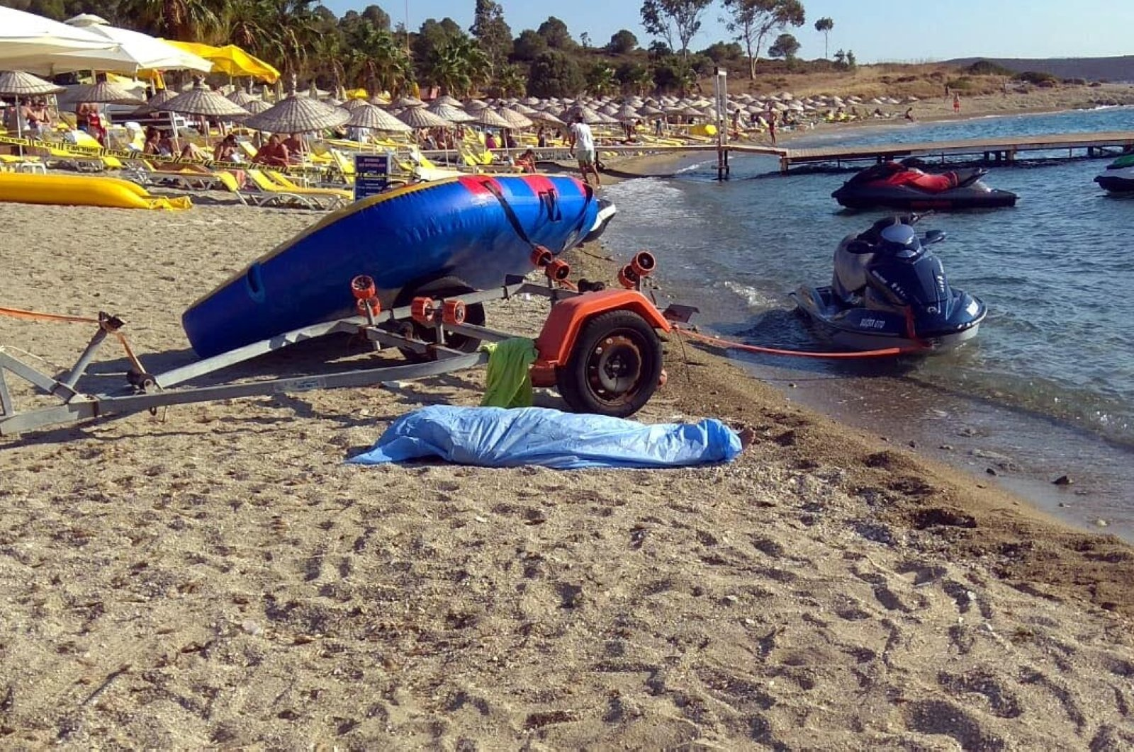 The capsized boat rests on the shore after the accident in the Foça district of Izmir, Turkey, Aug. 2, 2020. (DHA Photo)