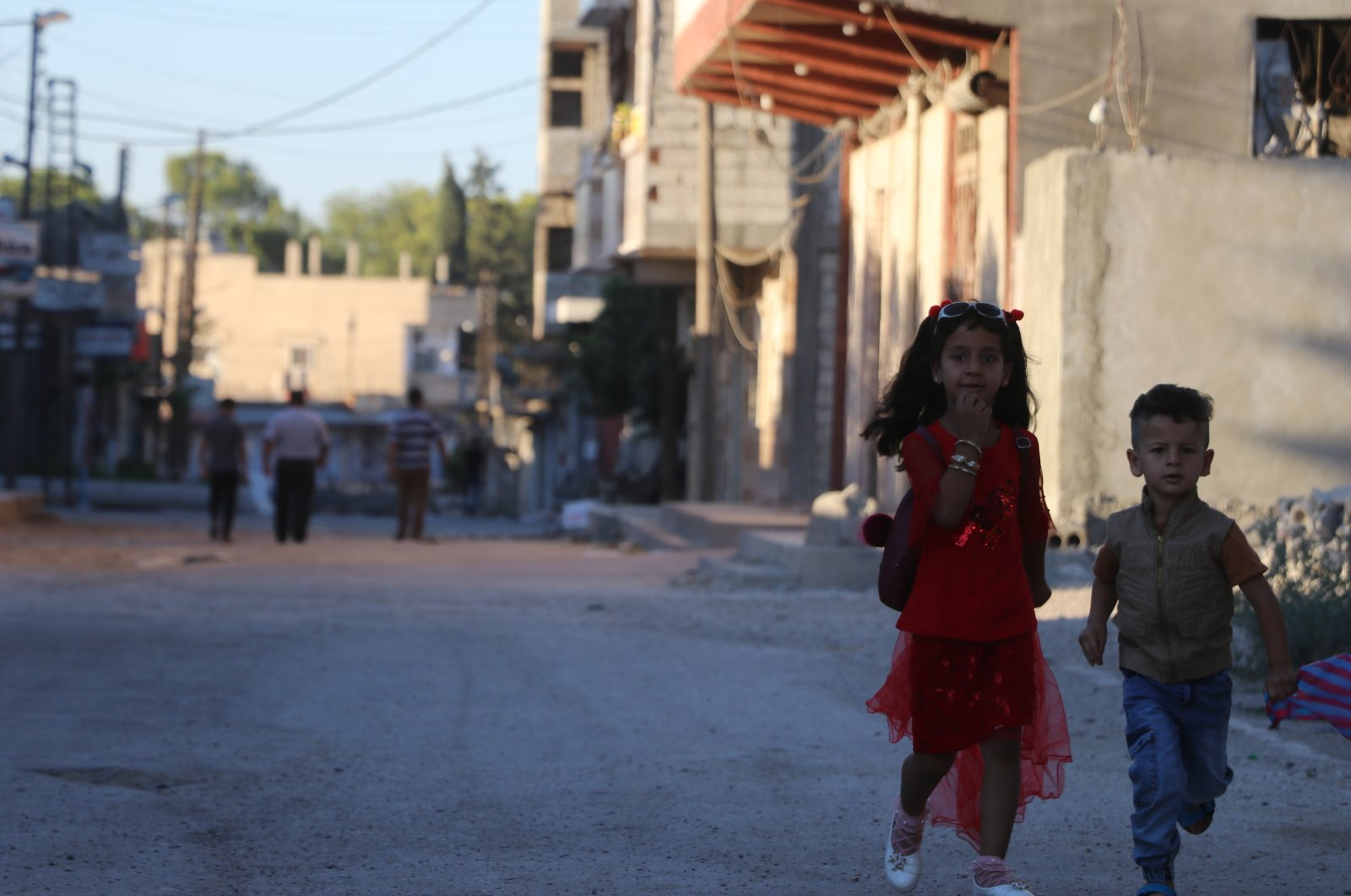 In this file photo, children run in a street in an area cleared of terrorists in Turkey's Operation Peace Spring in northern Syria, July 31, 2020. (AA Photo)