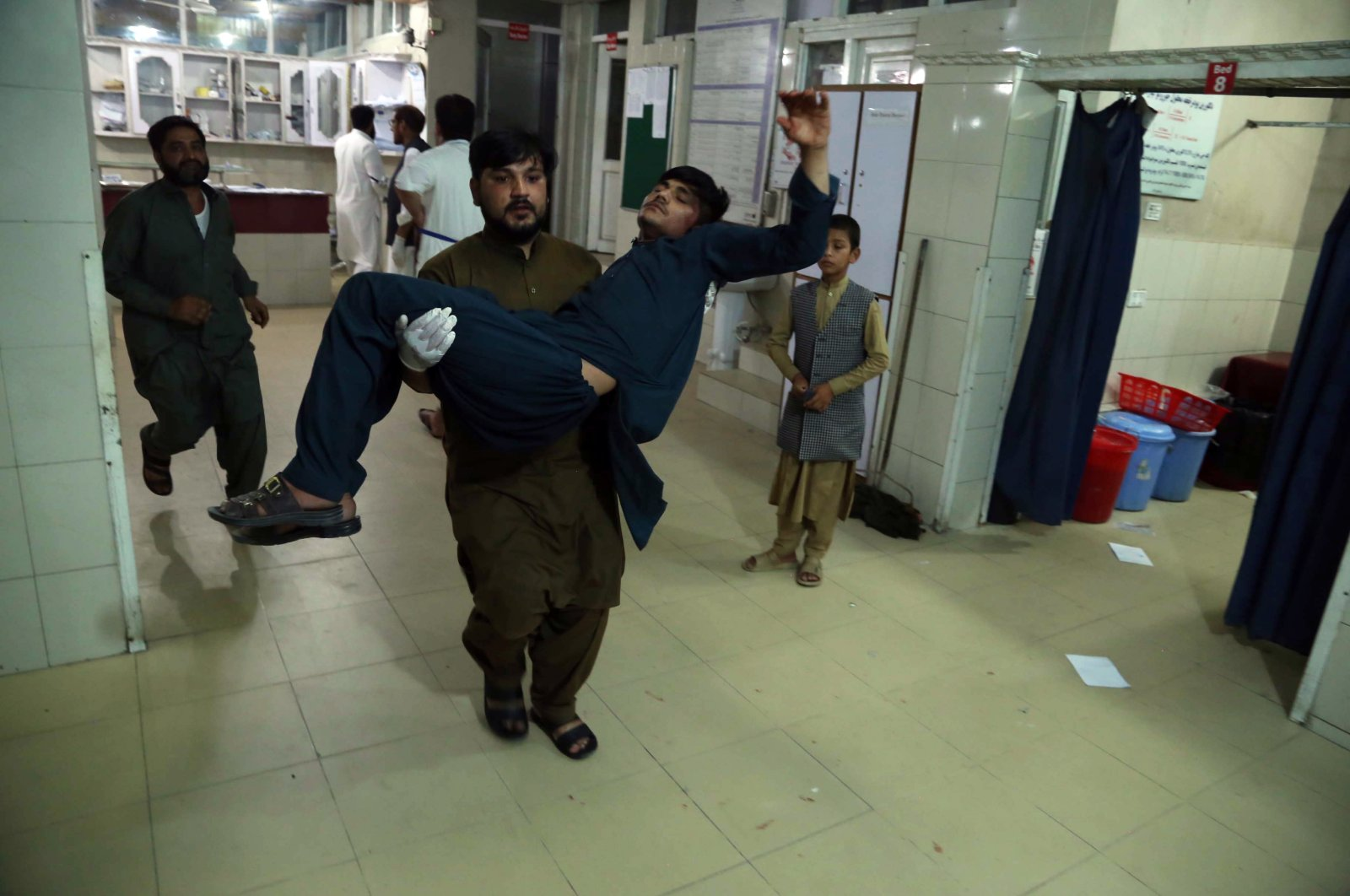 An Afghan man who was injured when militants attacked a central prison is transferred to a hospital in Jalalabad, Afghanistan, Aug. 2, 2020. (EPA Photo)