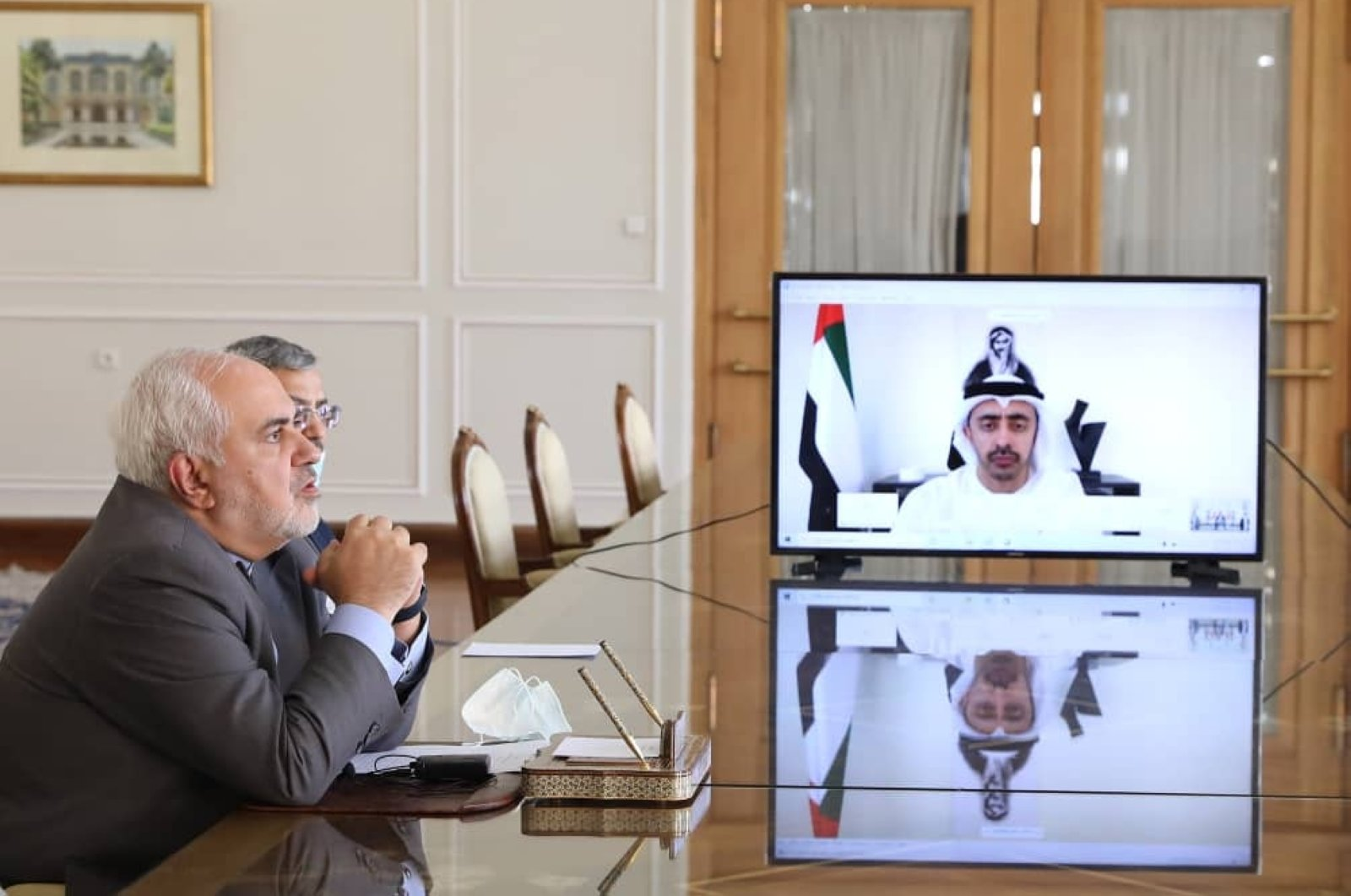 Foreign Minister Mohammad Javad Zarif (L) attends a video meeting with UAE's Foreign Minister Sheikh Abdullah bin Zayed al-Nahyan from Tehran, Iran, Aug. 2, 2020. (Iranian Ministry of Foreign Affairs via AFP)