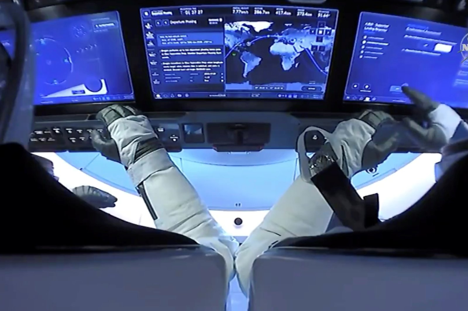 NASA astronauts Robert Behnken and Douglas Hurley are seen aboard SpaceX's Dragon Endeavour spacecraft, Aug. 2, 2020, in this screengrab taken from a video. (NASA handout via Reuters)