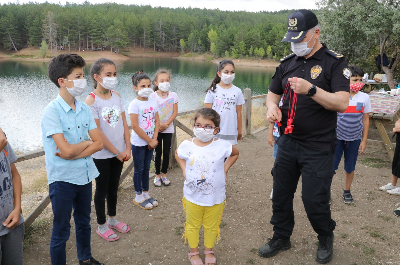 Police officers take part in a program to raise awareness about the coronavirus pandemic in central Yozgat province, Turkey, Aug. 2, 2020. (AA Photo)