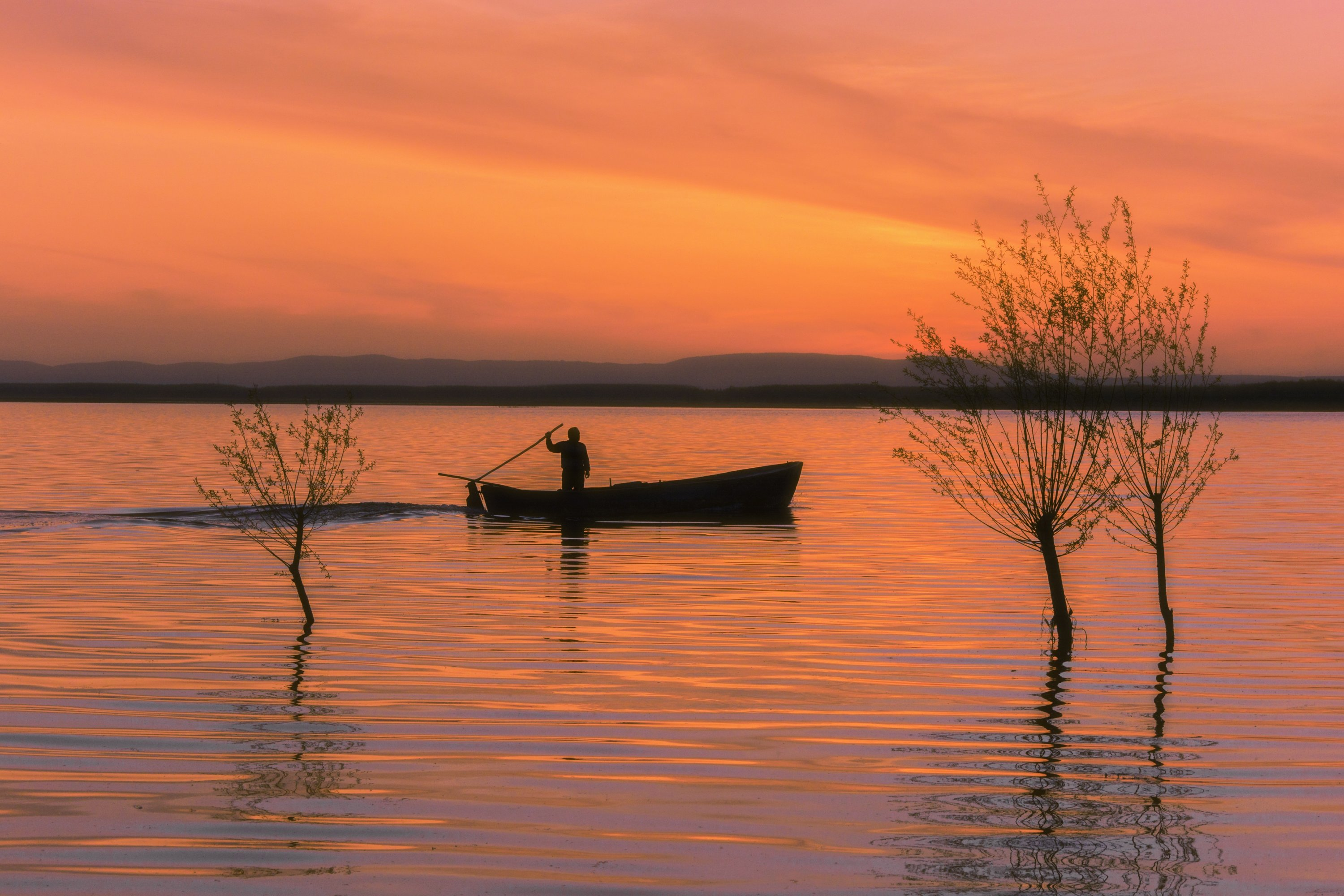 Take some amazing sunset photos at Lake Işıklı while enjoying a boat ride. (AA Photo)