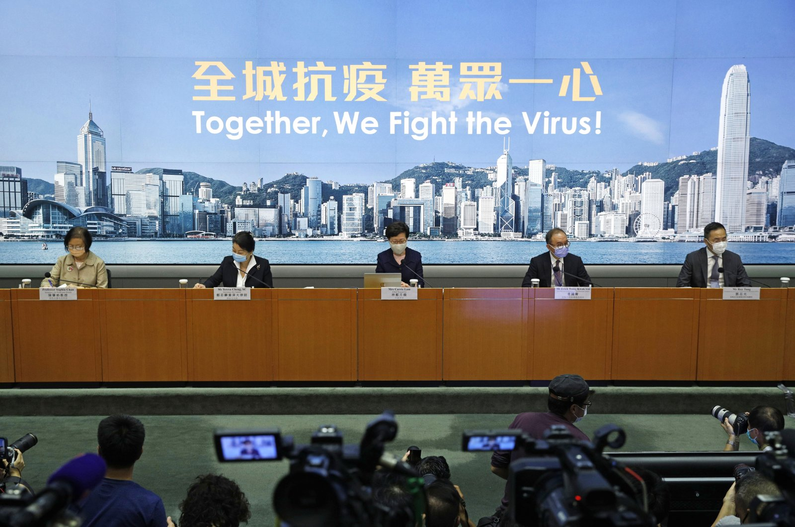 Hong Kong Chief Executive Carrie Lam (C) announces the postponement of legislative elections scheduled for Sept. 6, citing a worsening coronavirus outbreak, during a press conference in Hong Kong, July 31, 2020. (AP Photo)