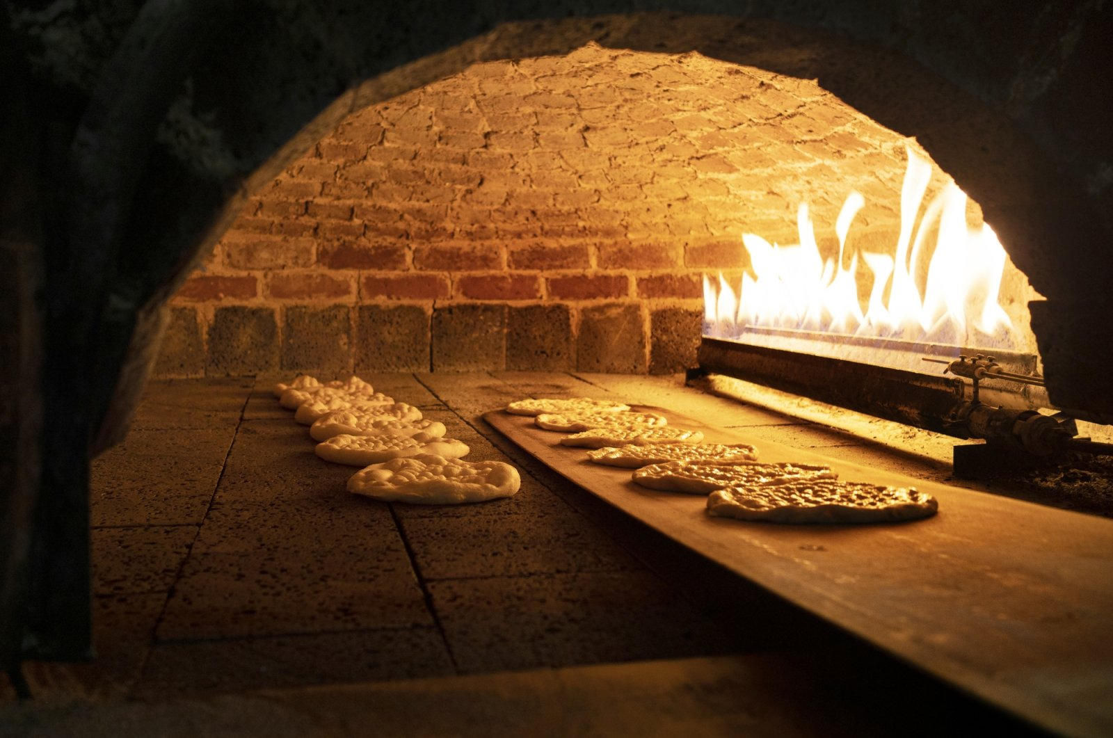 A lot of traditional Turkish breads are baked in wood-fired brick ovens, which keeps them airy and crispy. (iStock Photo)