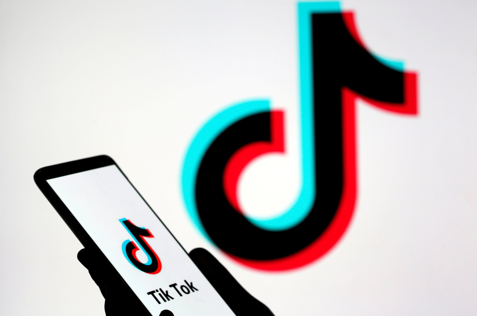 A person holds a smartphone with the TikTok logo displayed in this picture illustration taken Nov. 7, 2019. (Reuters Photo)