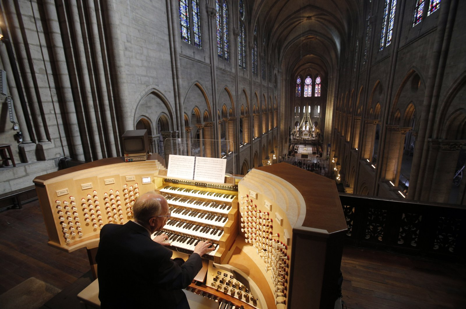 Philippe Lefebvre, 64, plays the organ at Notre Dame cathedral in Paris on May 2, 2013. (AP Photo)
