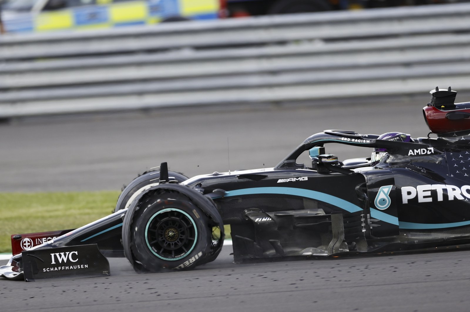 Mercedes driver Lewis Hamilton seen with a flat tire during the final lap of Formula 1 British Grand Prix race in Northamptonshire, Britain, Aug. 2, 2020. (EPA Photo)