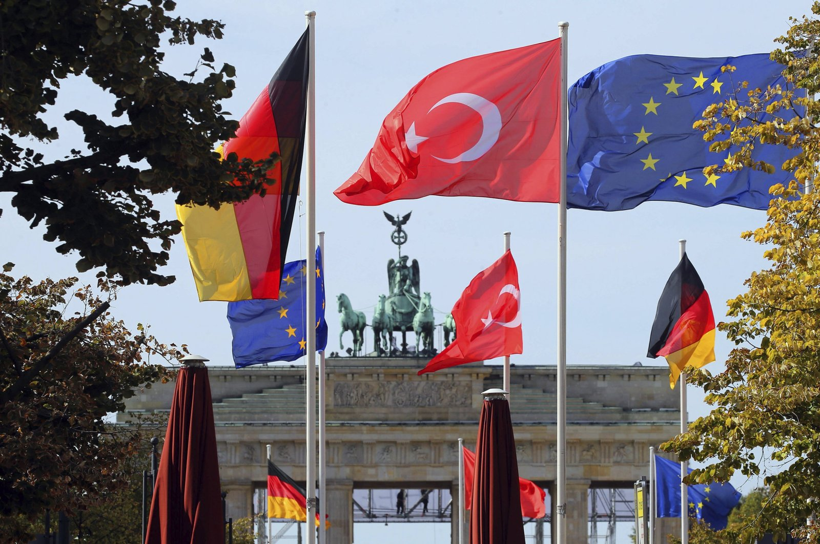 The flags of Turkey, Germany and the European Union flutter in front of the Brandenburg Gate in Berlin, Sept. 26, 2018. (AFP Photo)