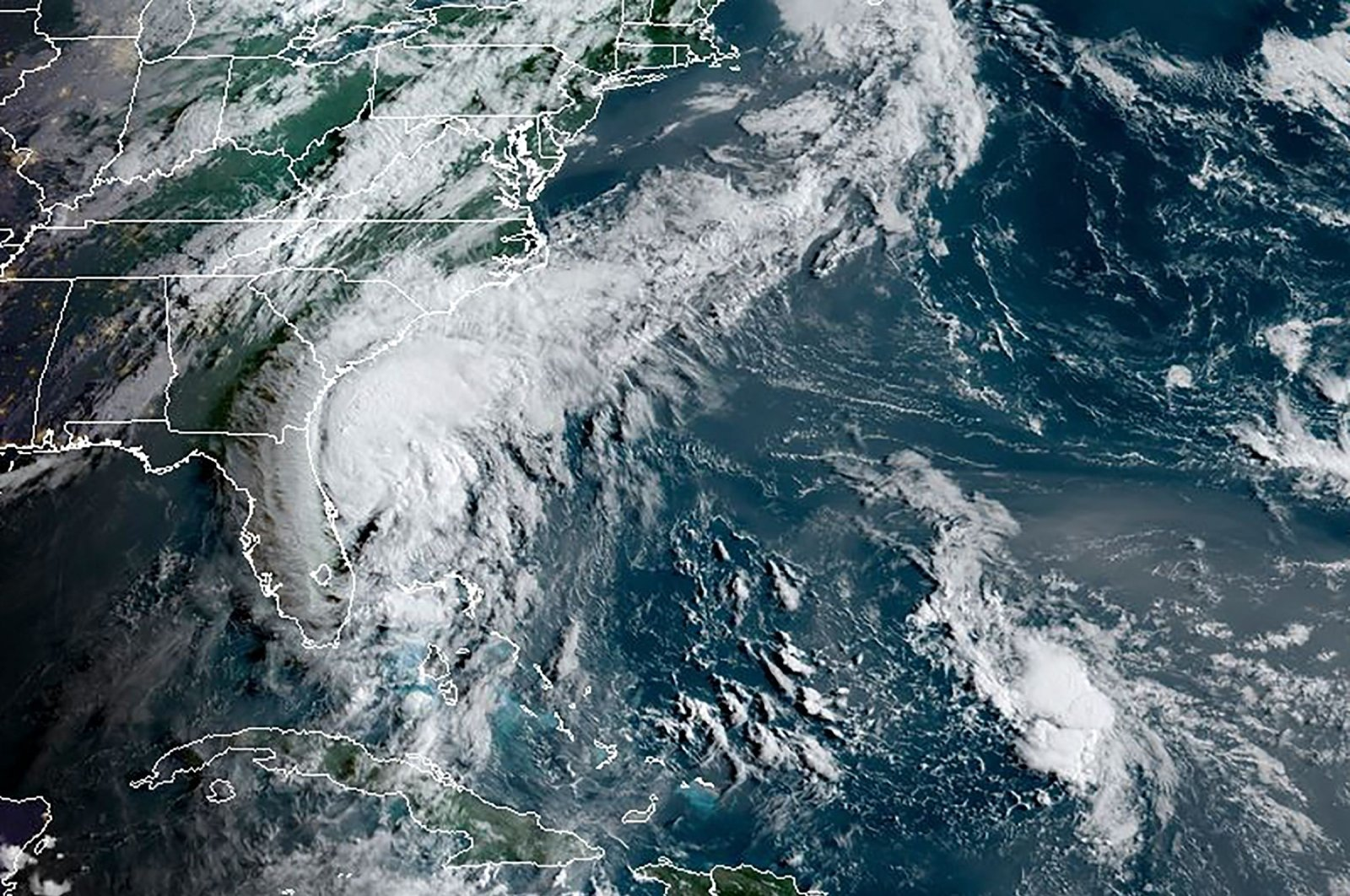 Tropical storm Isaias is seen off the southeast coast of the U.S. in the Atlantic Ocean in this RAMMB/NOAA satellite image obtained Aug. 3, 2020. (RAMMB/NOAA handout via AFP)