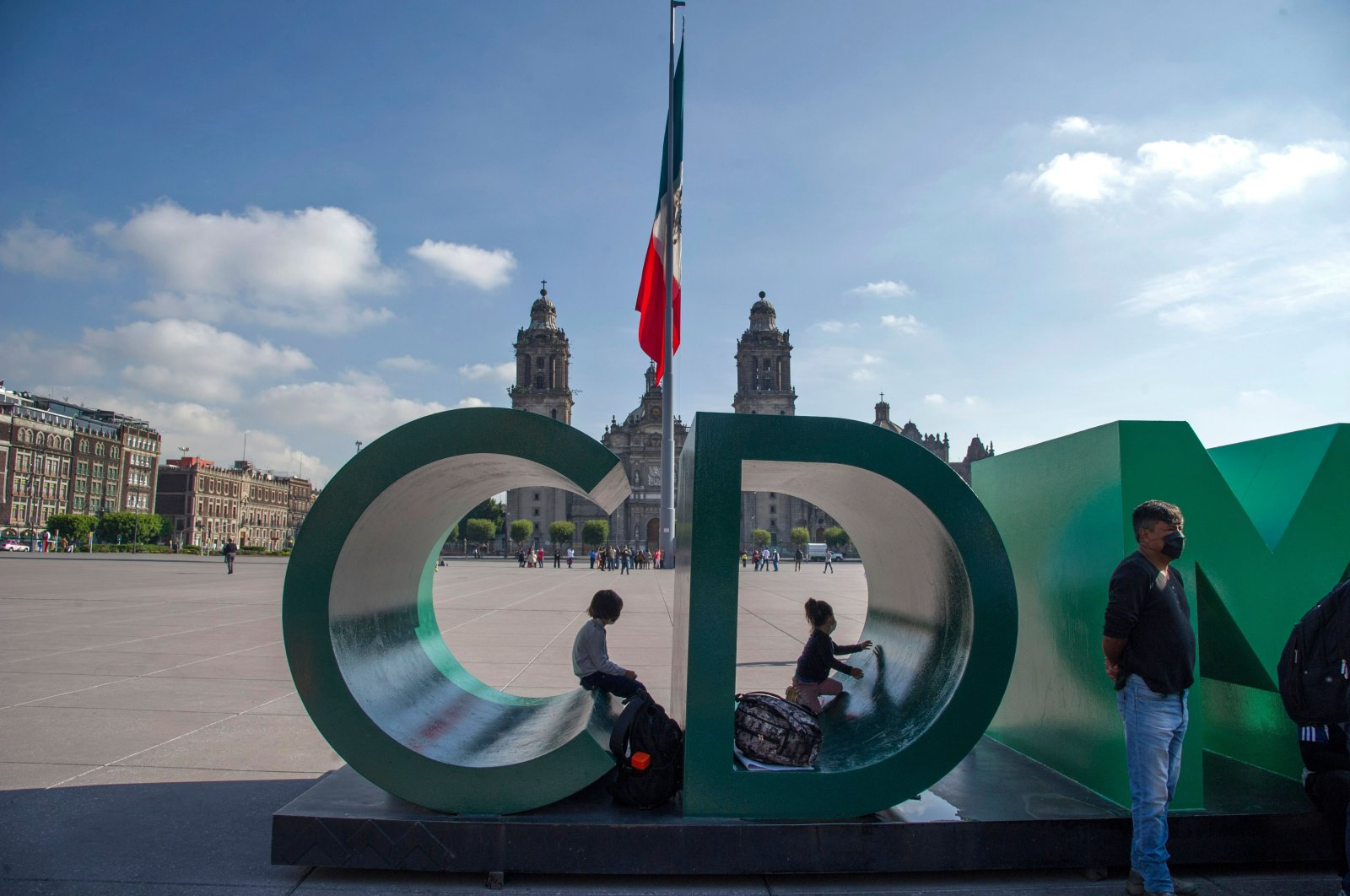 Children plays at Zocalo square in the historic center of Mexico City, Mexico on July 22, 2020, amid the COVID-19 pandemic. (AFP Photo)