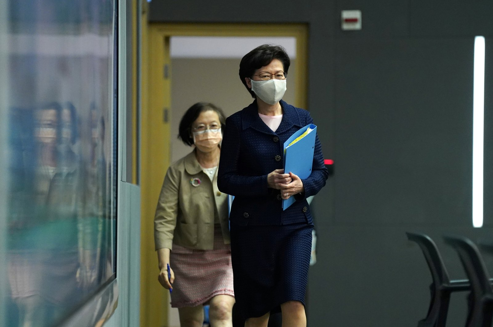 Hong Kong Chief Executive Carrie Lam, wearing a face mask following the coronavirus outbreak, arrives for a news conference in Hong Kong, China, July 31, 2020. (Reuters Photo)