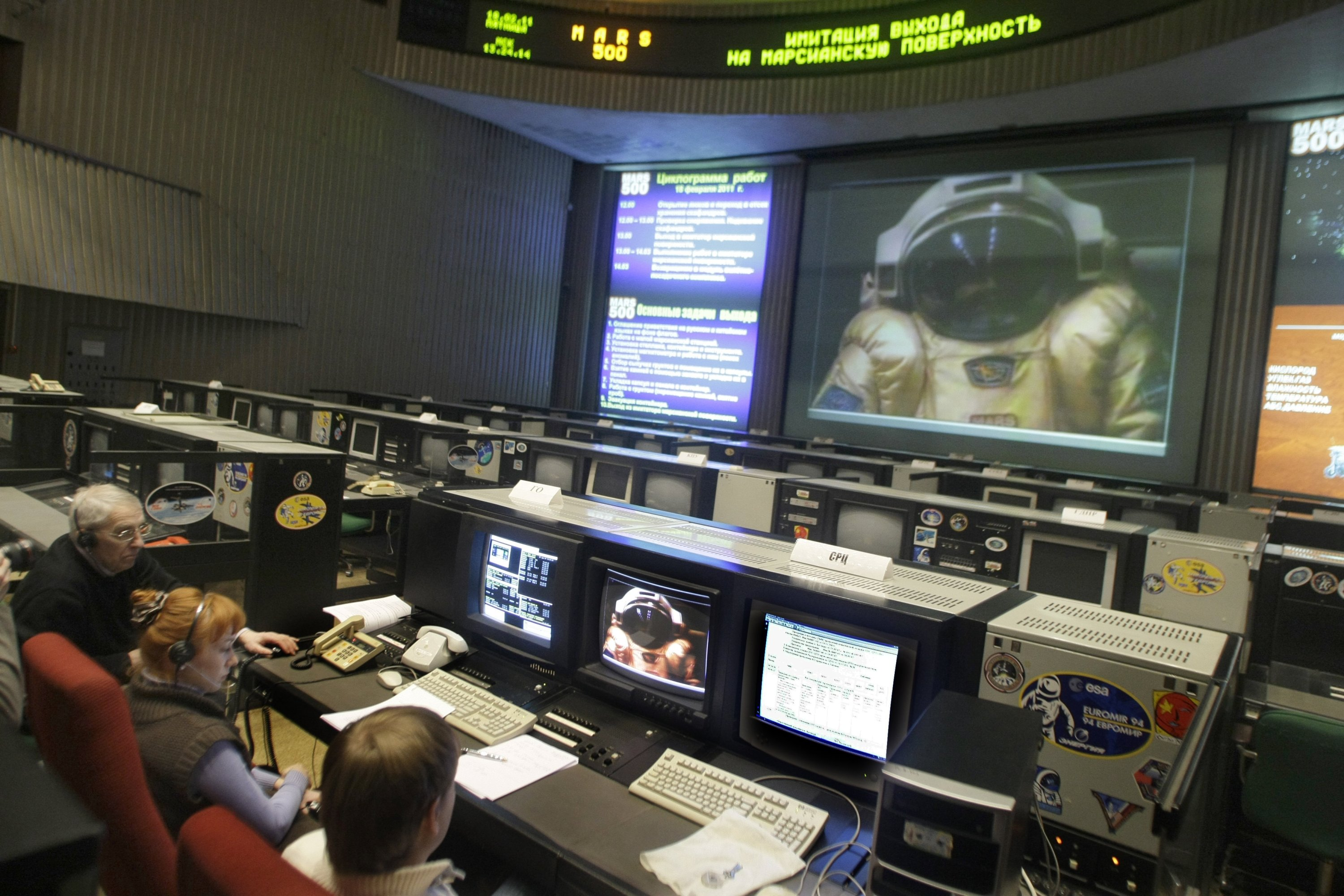 Russian space specialists sit at the controls as they simulate a landing on Mars with space crew acting out the landing, at the Mission Control Center in Korolyov, just outside Moscow, Russia, Friday, Feb. 18, 2011. (AP Photo)