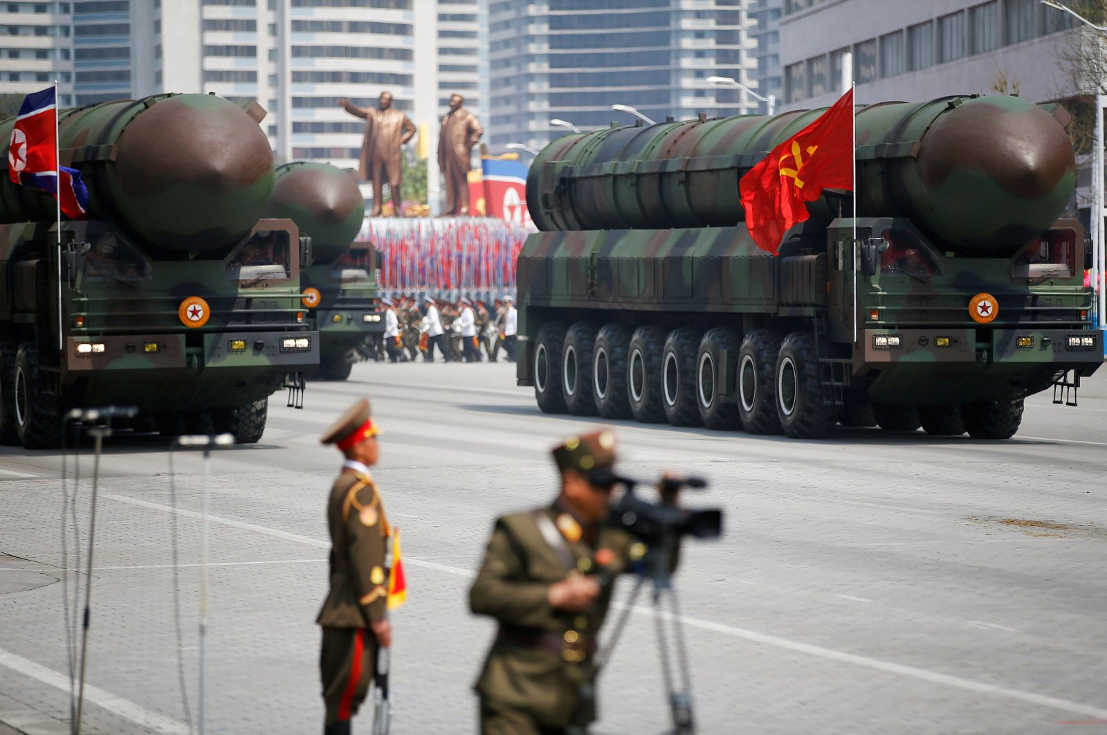 Intercontinental ballistic missiles (ICBM) are driven past a platform where North Korean leader Kim Jong Un and other high ranking stand during a military parade marking the 105th birth anniversary of the country's founding father Kim Il Sung, in Pyongyang, North Korea, April 15, 2017. (Reuters Photo)