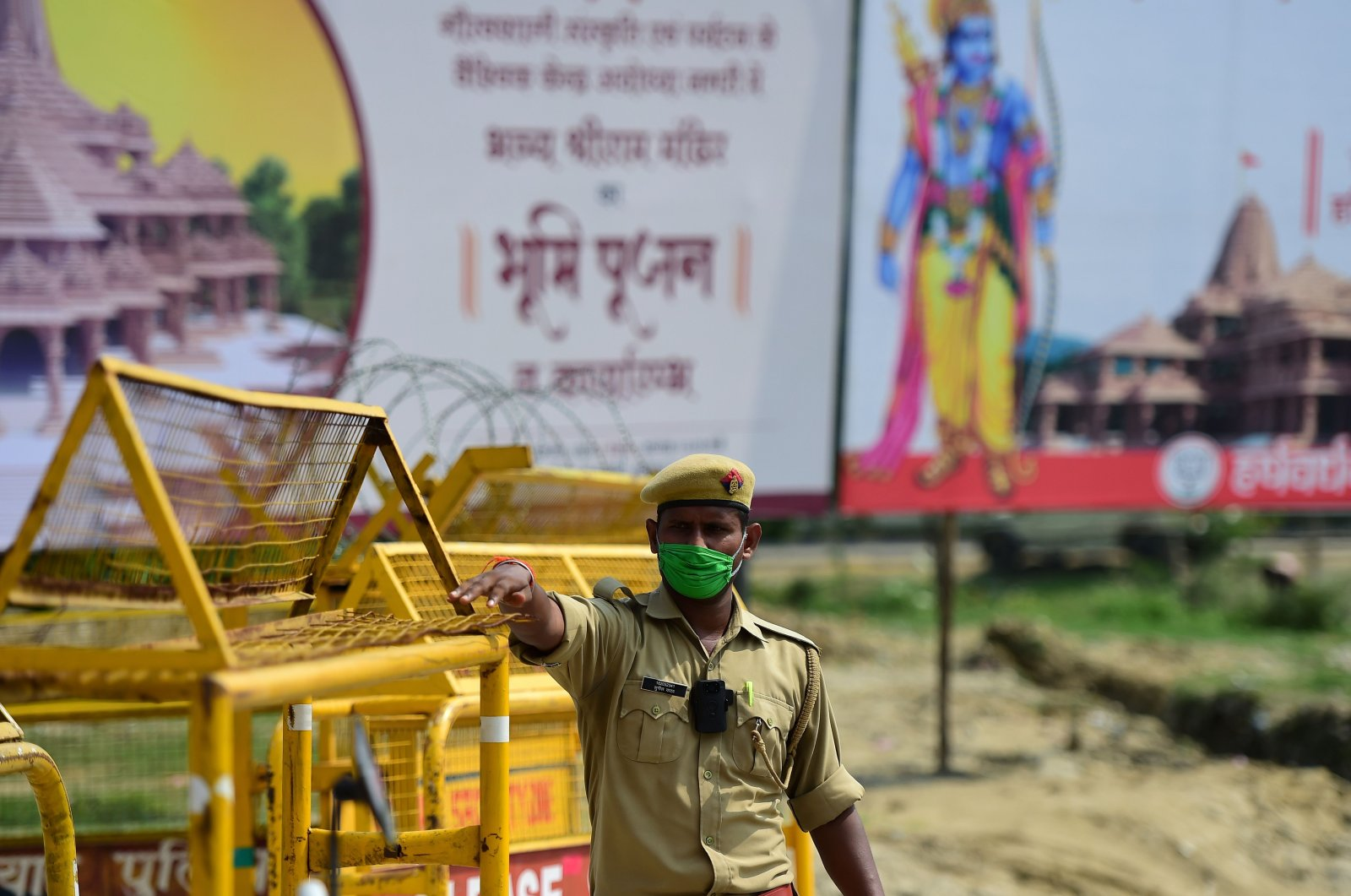 A policeman gestures as he stands at a checkpoint ahead of the ground-breaking ceremony of the proposed Ram Temple in Ayodhya, India, Aug. 4, 2020. (AFP Photo)